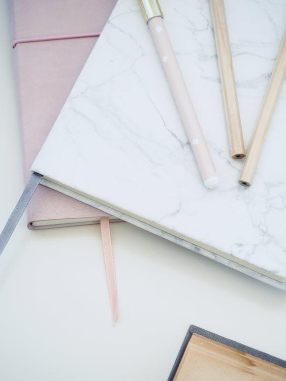 Three Pens on White Book