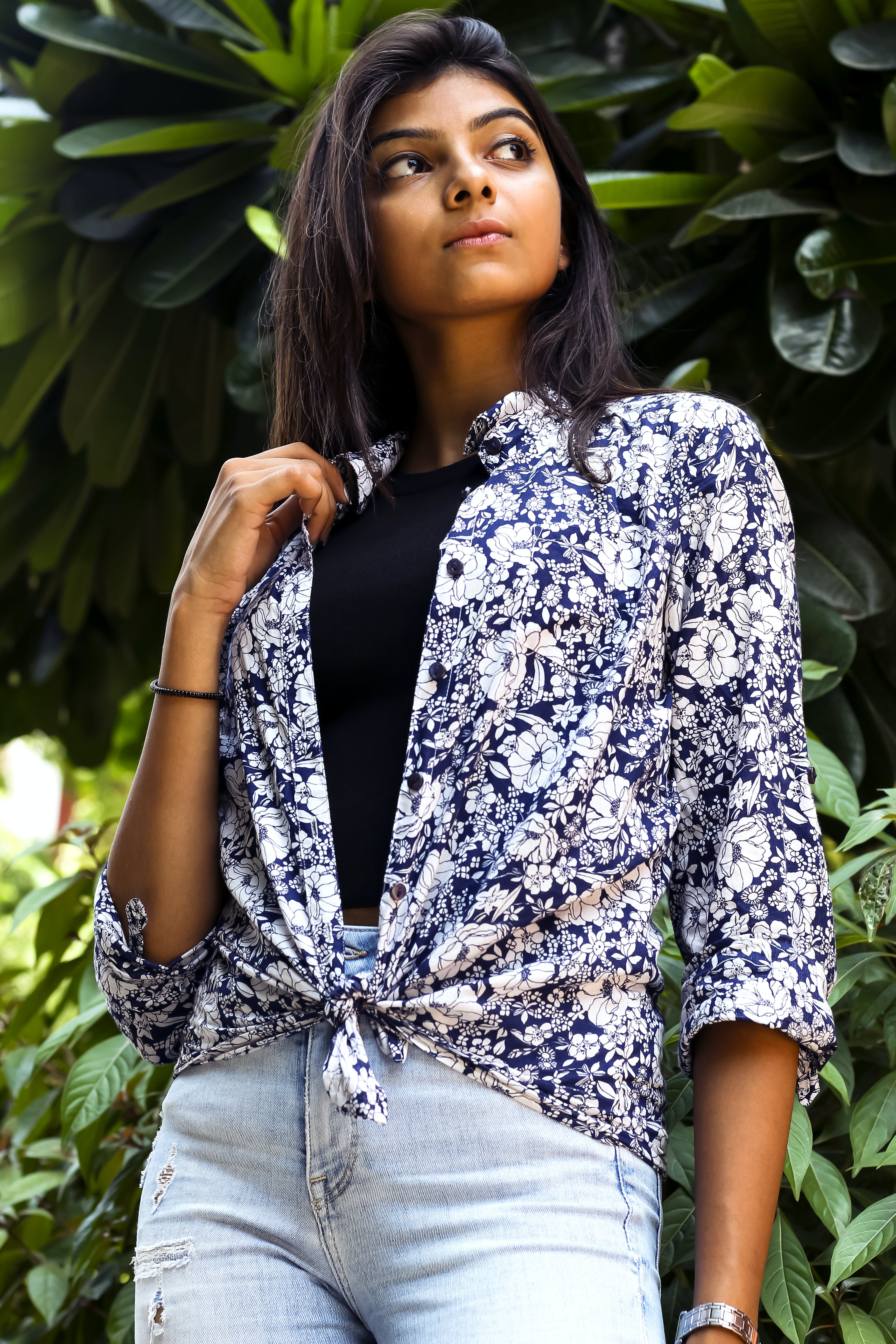 Woman In Blue And White Floral Top