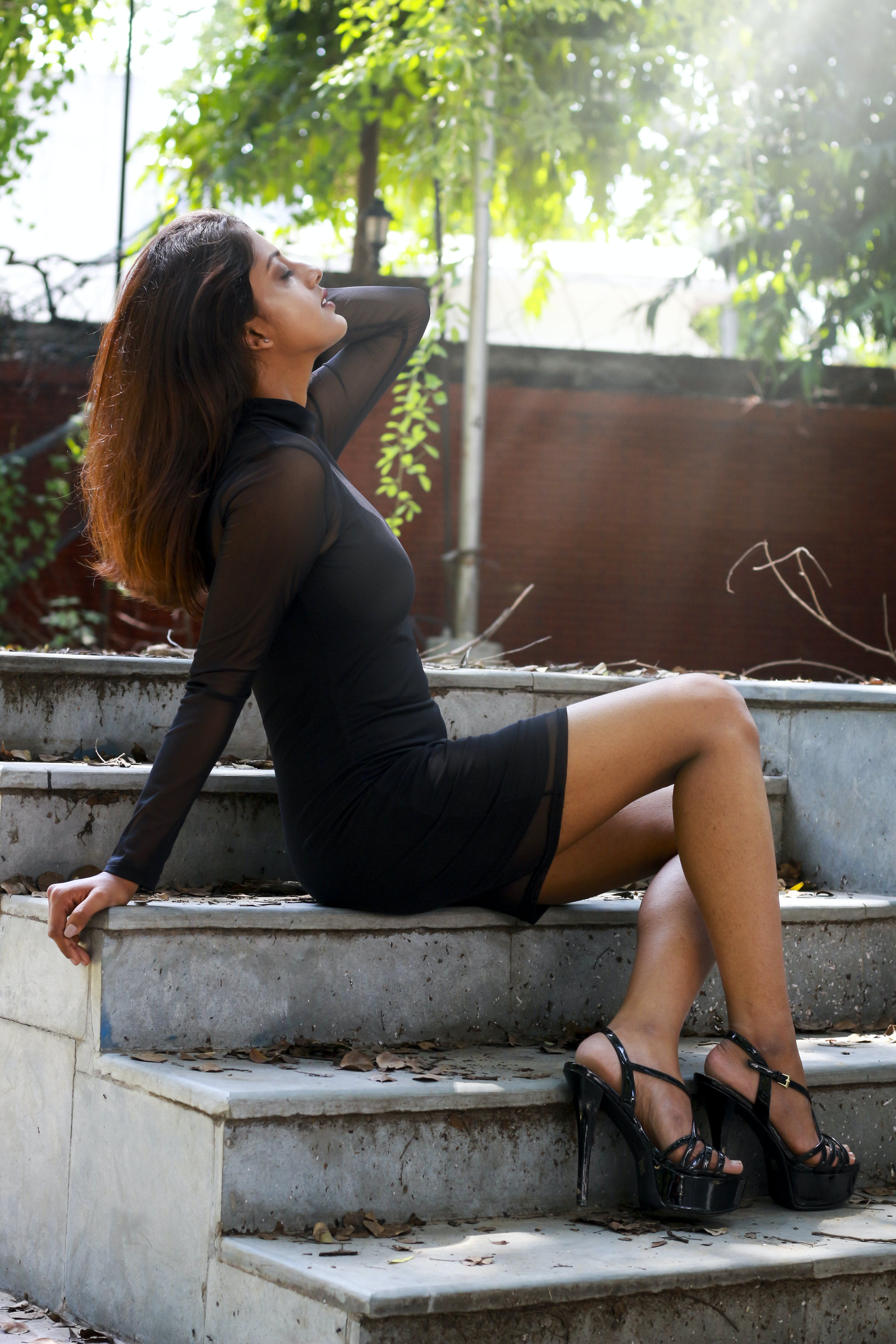 Person Wearing Black Long-sleeved Mini Dress