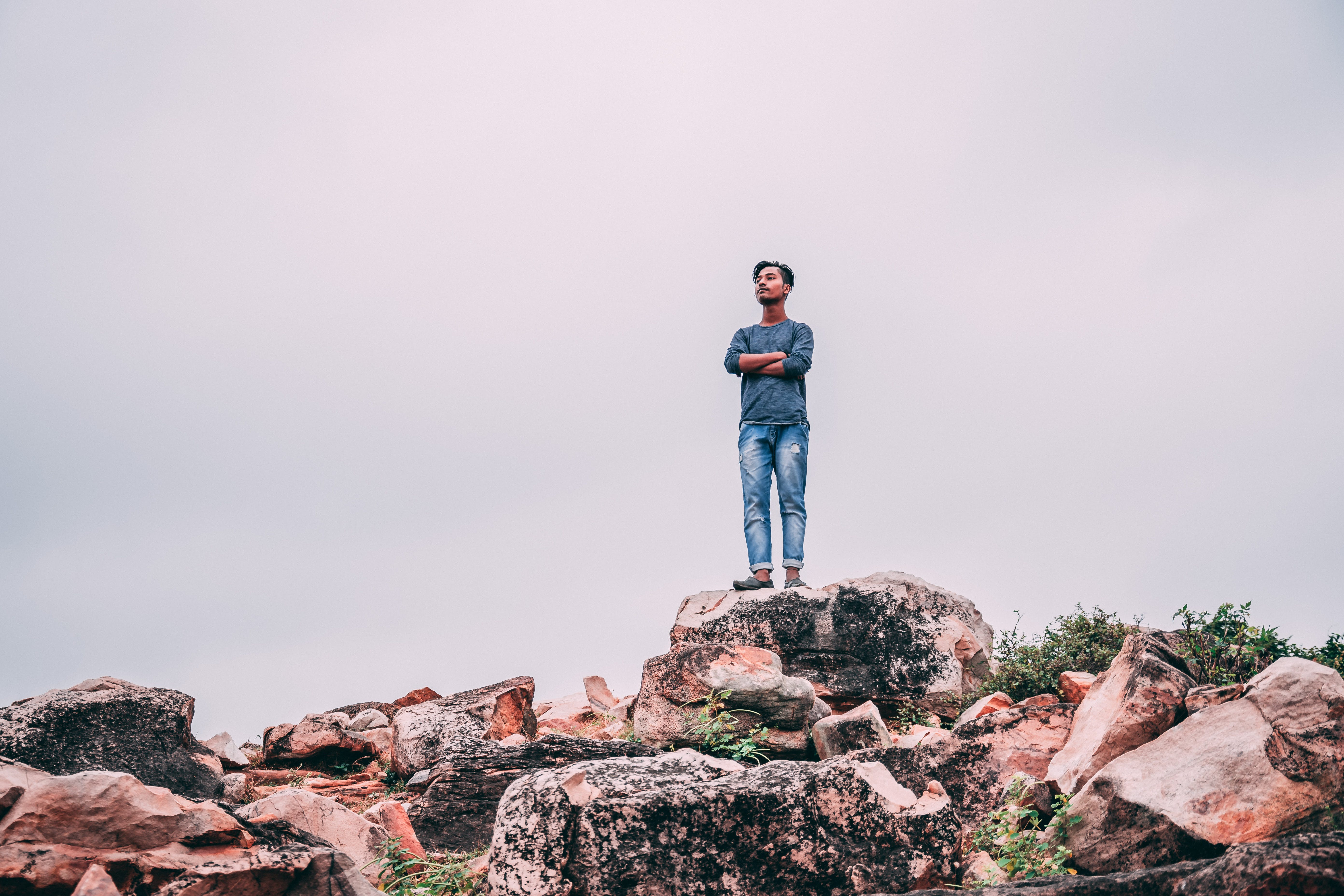 Man Standing On Rock