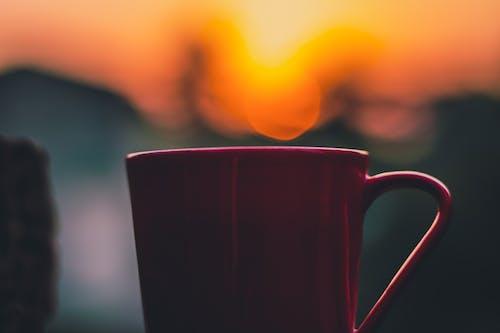 Selective Focus Photography of Red Mug