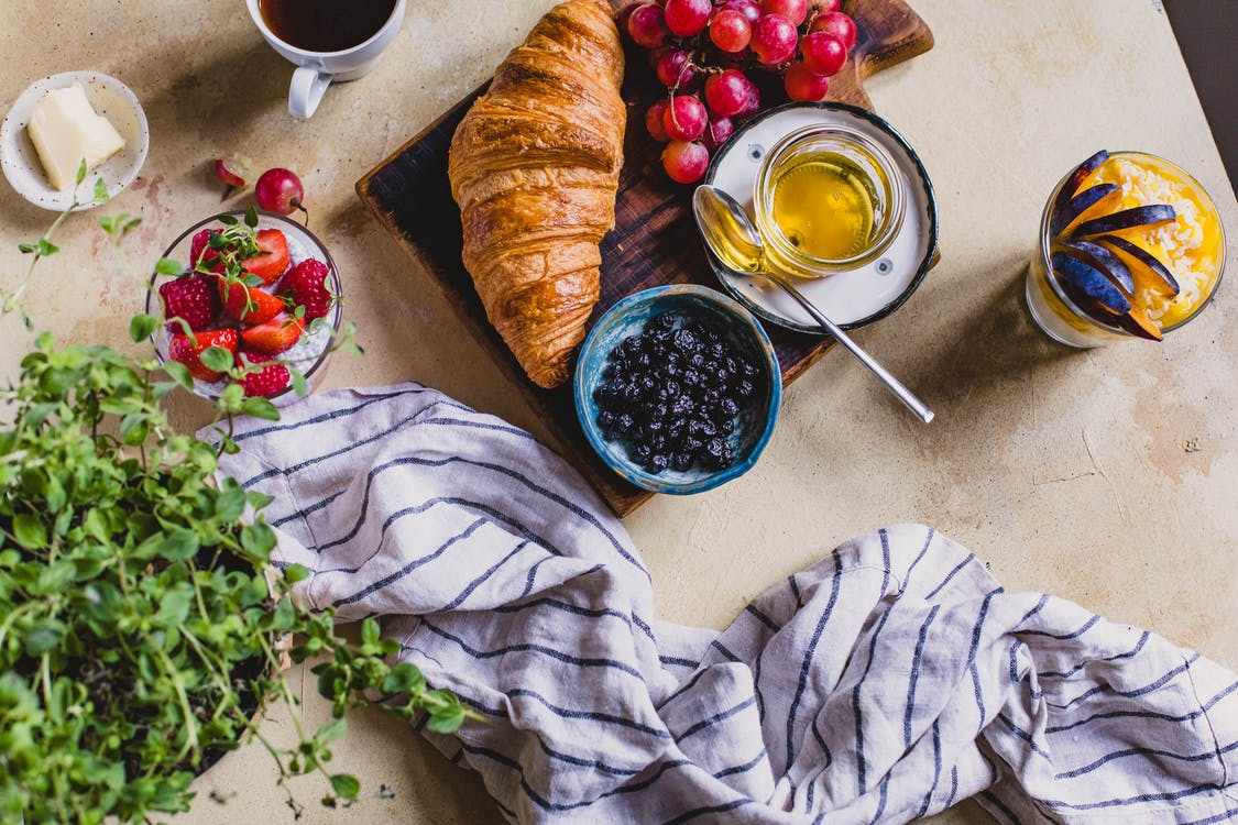 Croissant Bread On Table Beside Berries