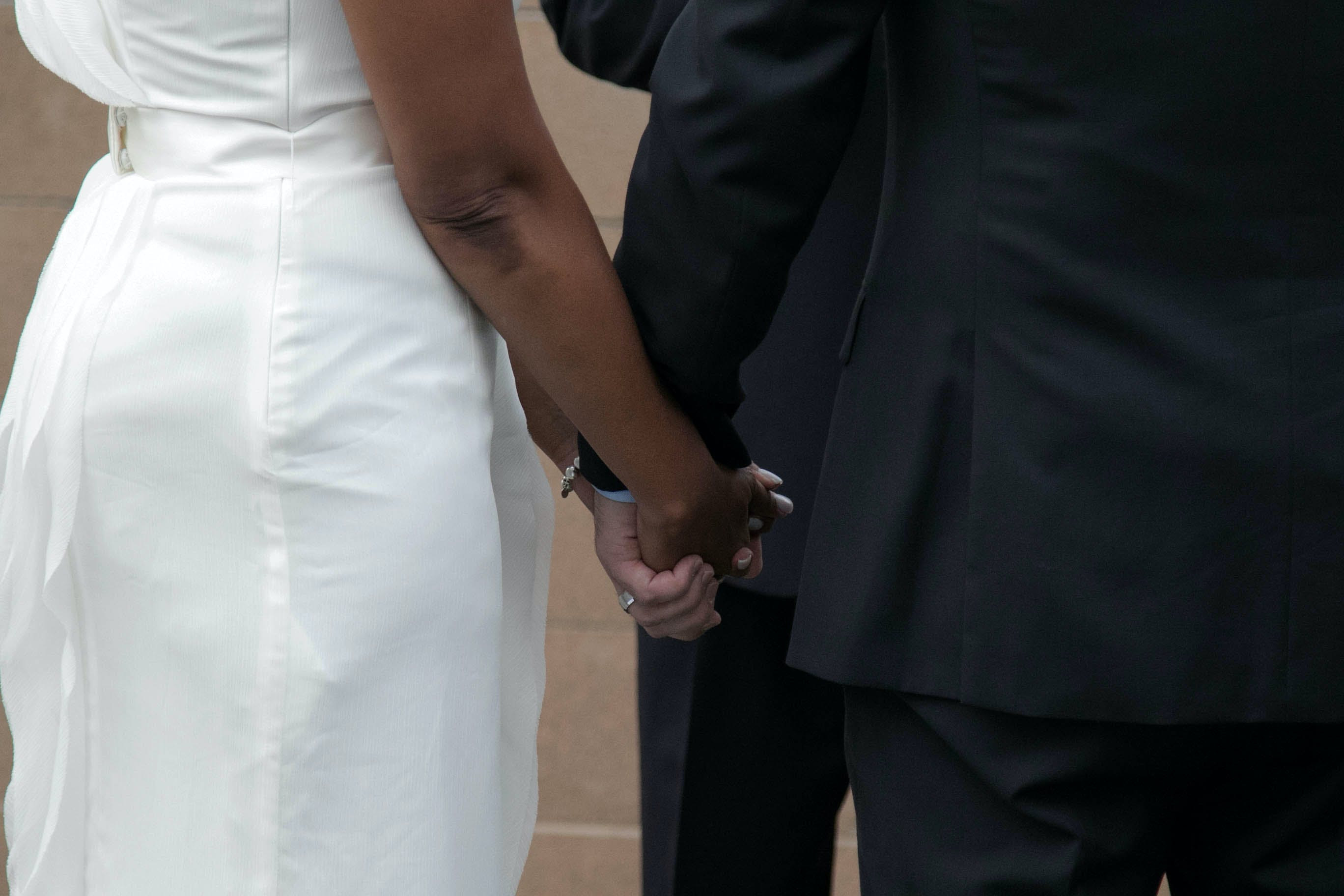 Free stock photo of bi racial couple, couple, holding hands, husband and wife