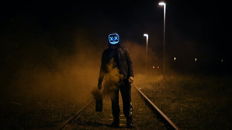 Man Wearing Black Jacket Standing On Railroad