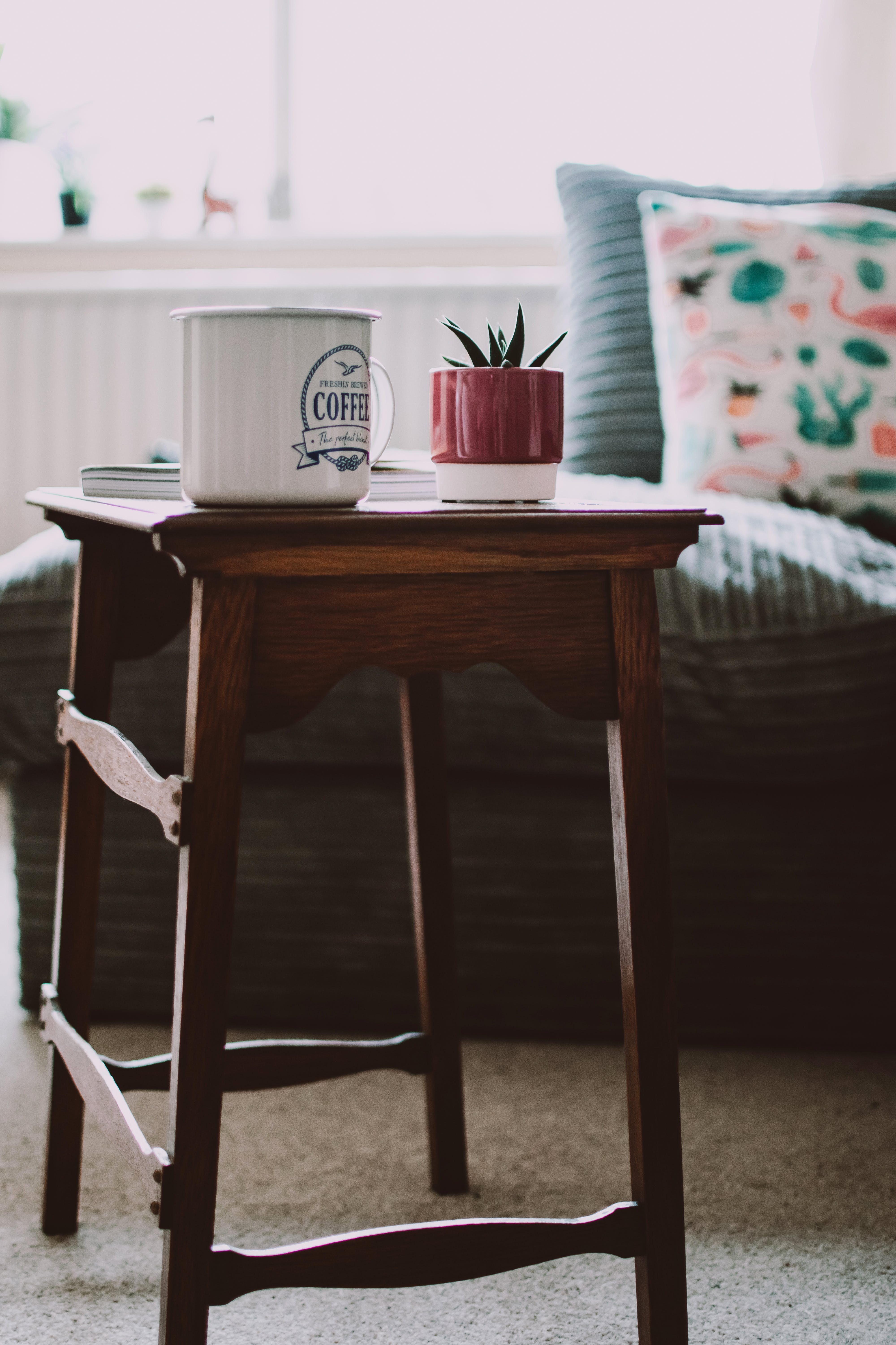 Selective Focus Photography of White Mug on Wooden Stool