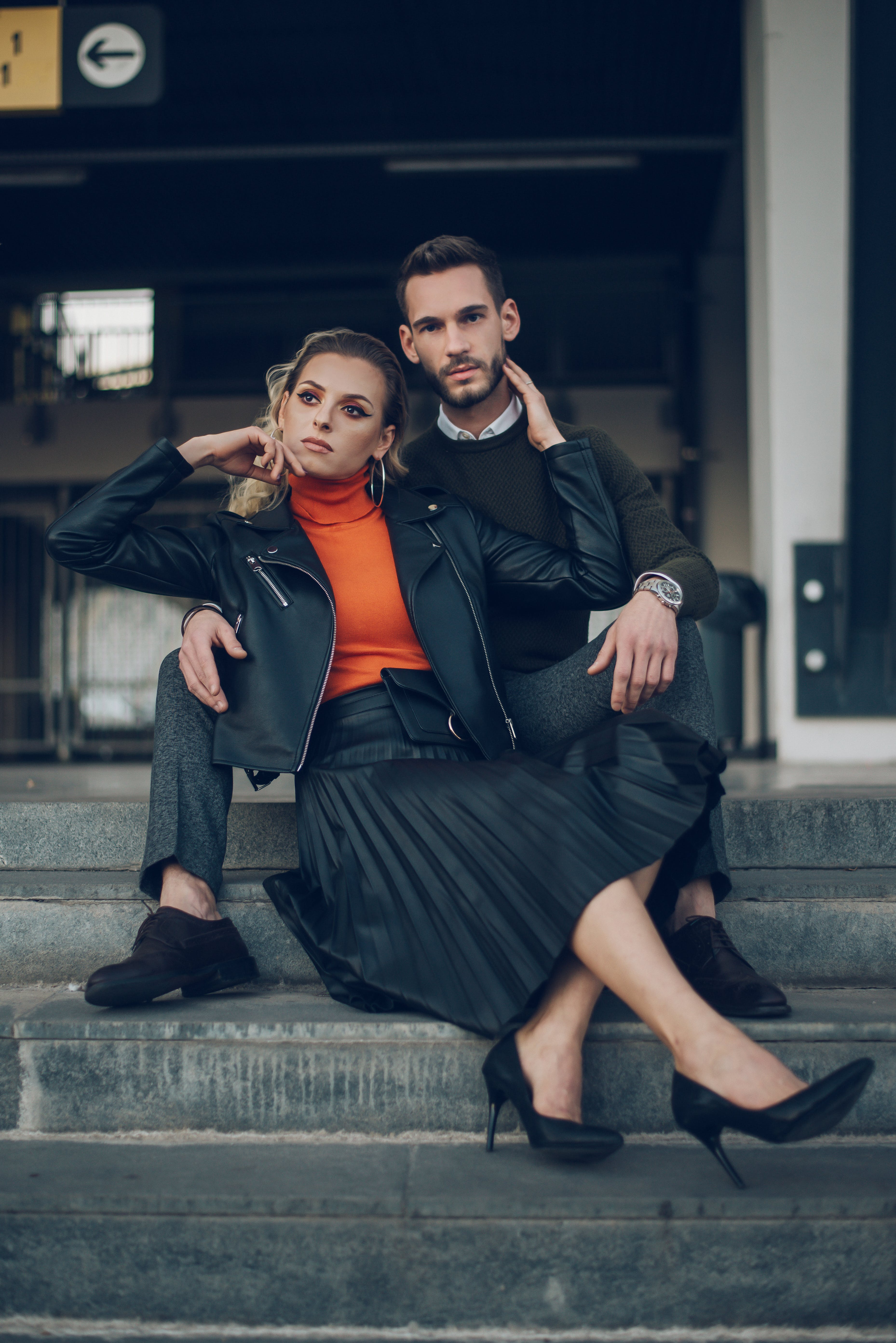 Selective Focus Photography of Woman Sitting on Concrete Stair Leaning on Man