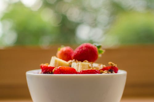 Selective Focus Photography of Strawberry and Banana in White Bowl