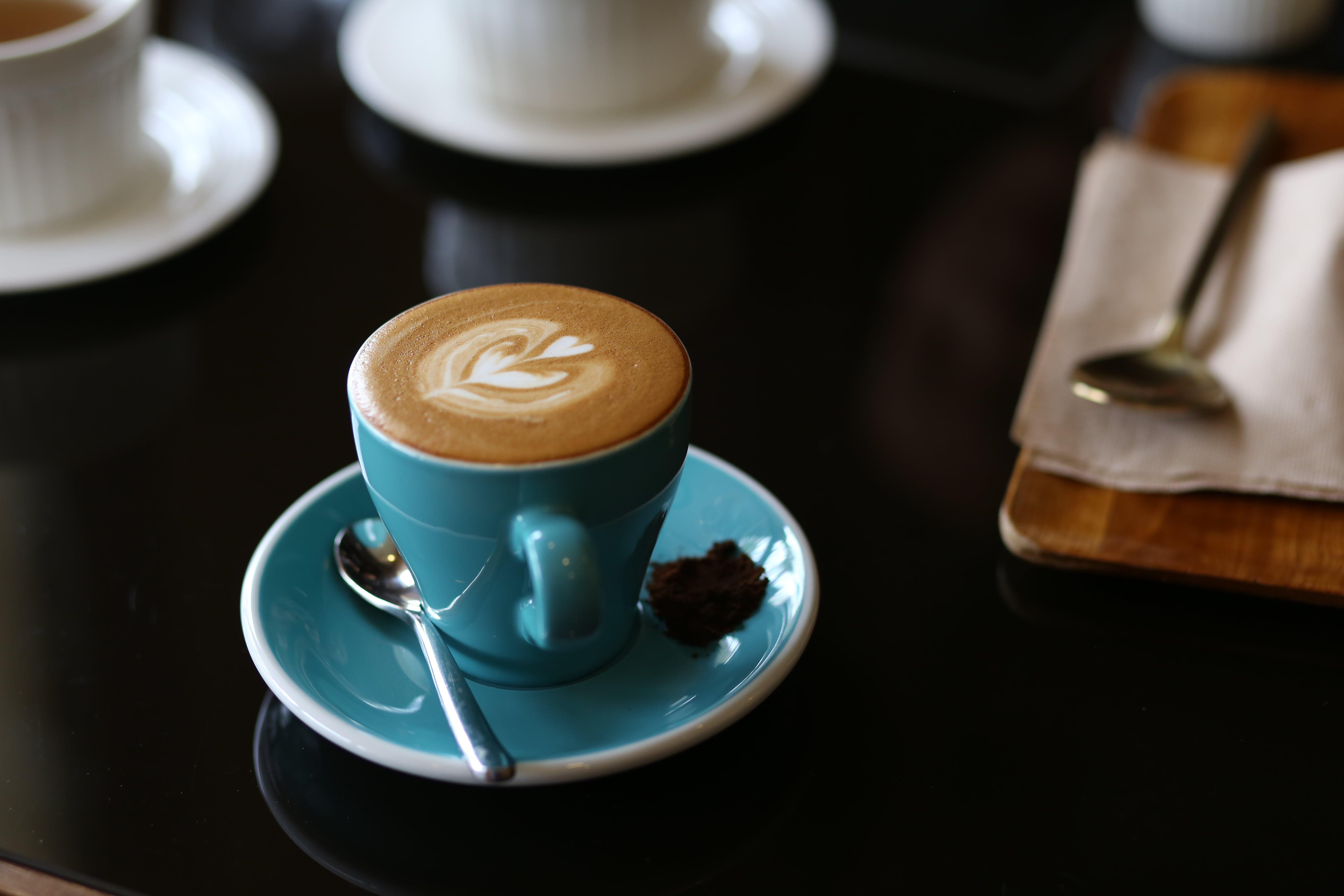 Blue Ceramic Mug Filled With Coffee