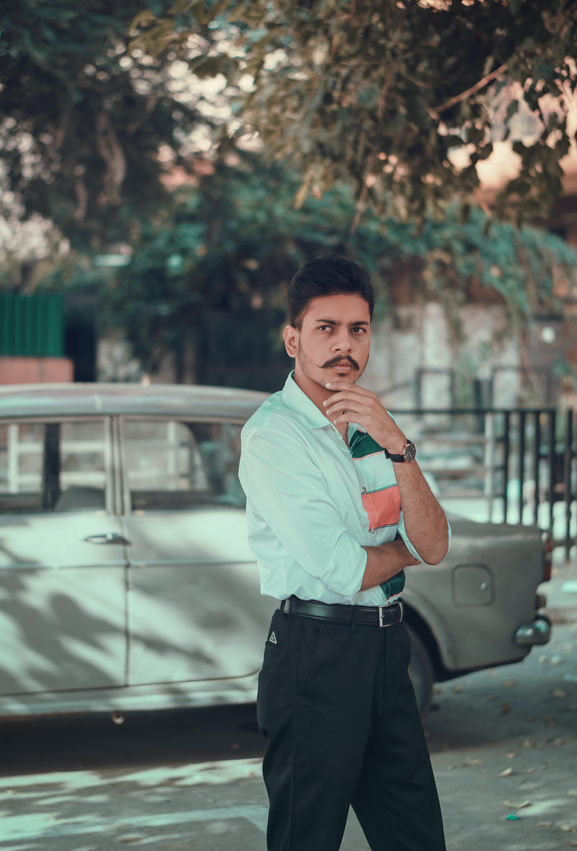 Photo of Man Wearing Teal Shirt