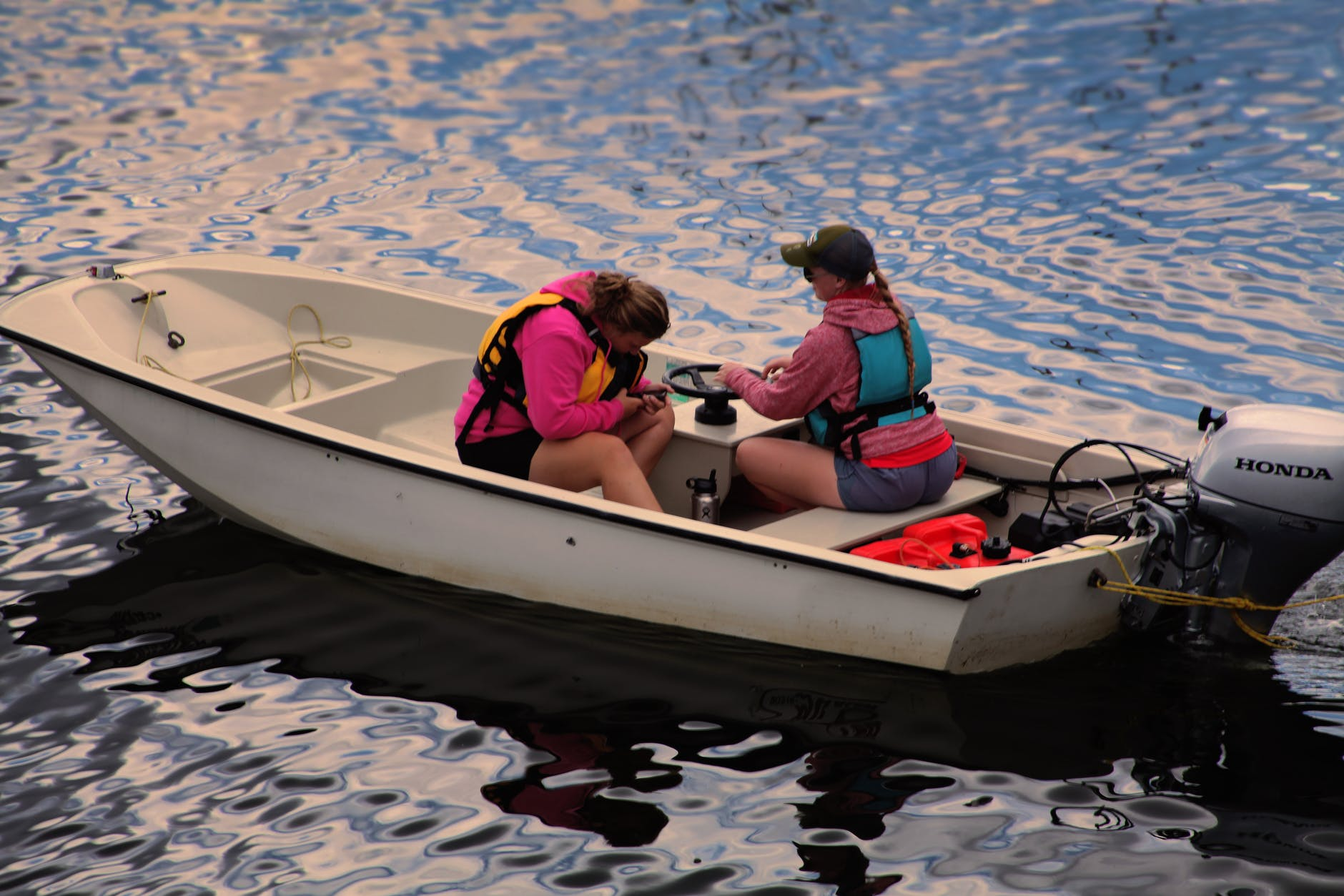 Insurance for Recreational Vehicles: two women in a fishing boat