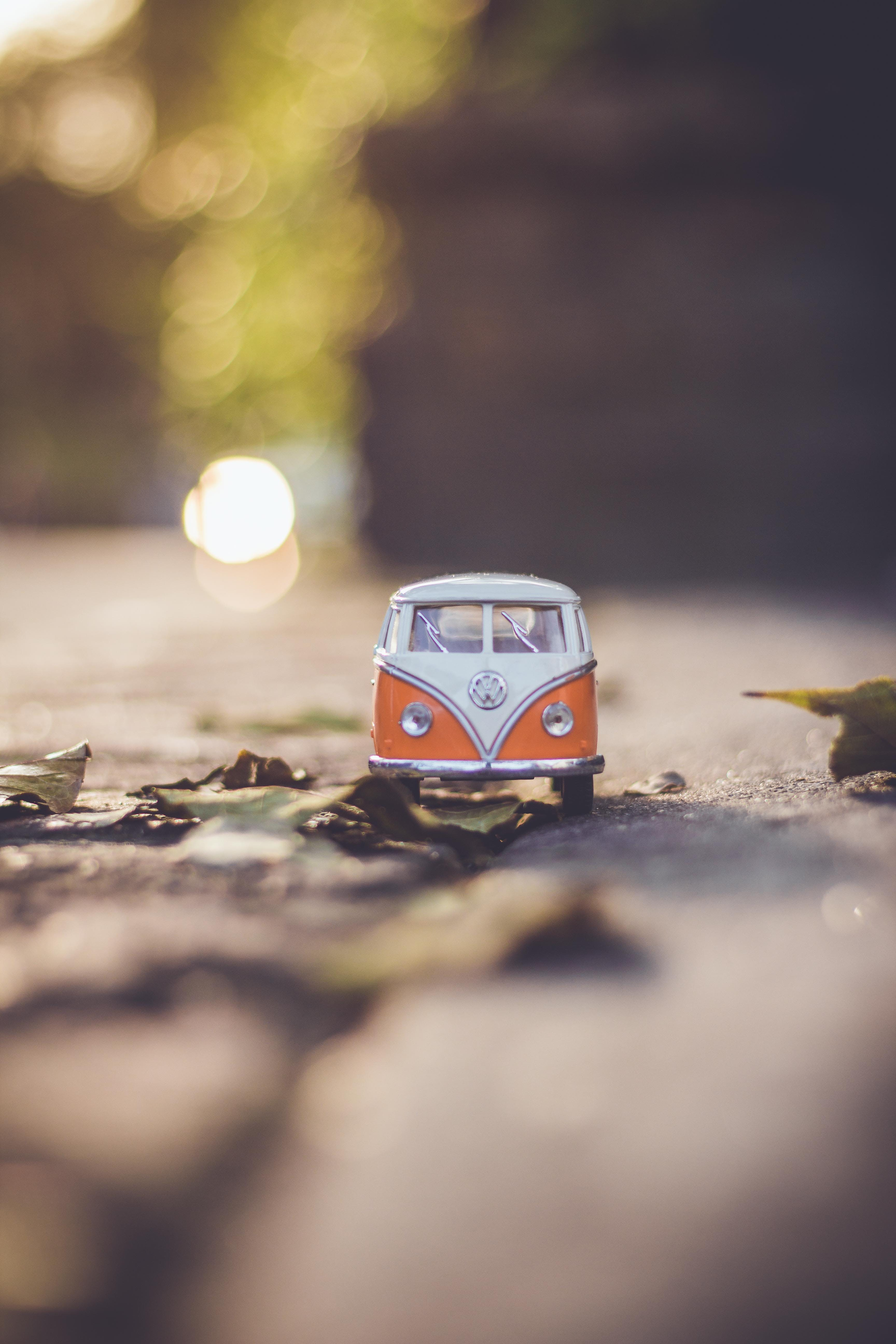Selective Focus Photography of White Volkswagen T2 Van Model on Ground