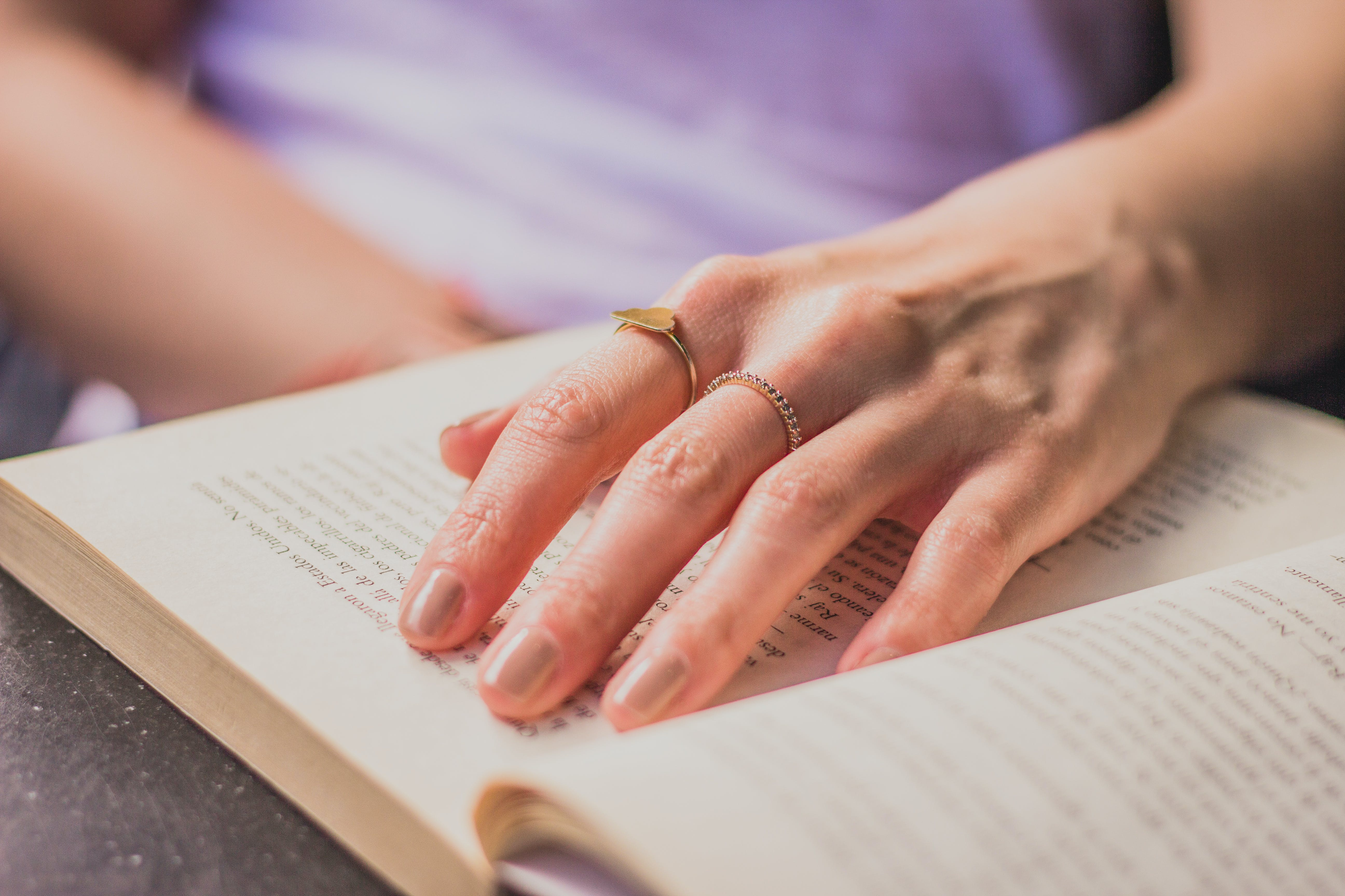 Close-up Photography Of Person Holding Opened Book