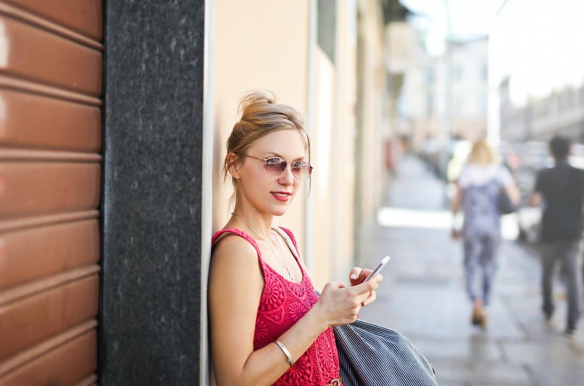 Photo of a Woman Leaning on a Wall