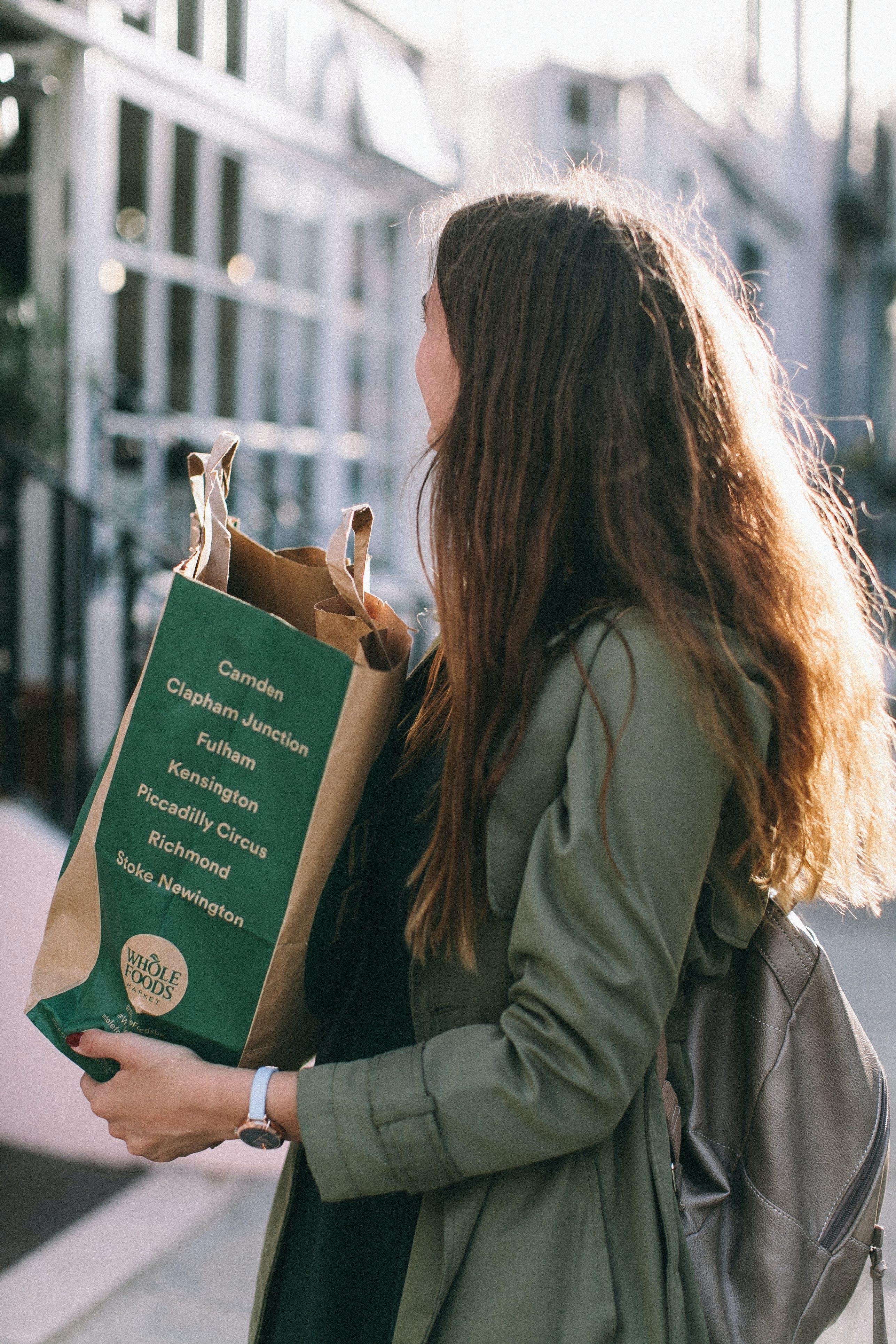 Woman Carrying Paper Bag