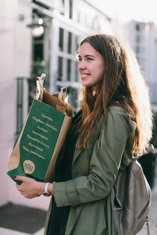Woman Carrying Paper Bag
