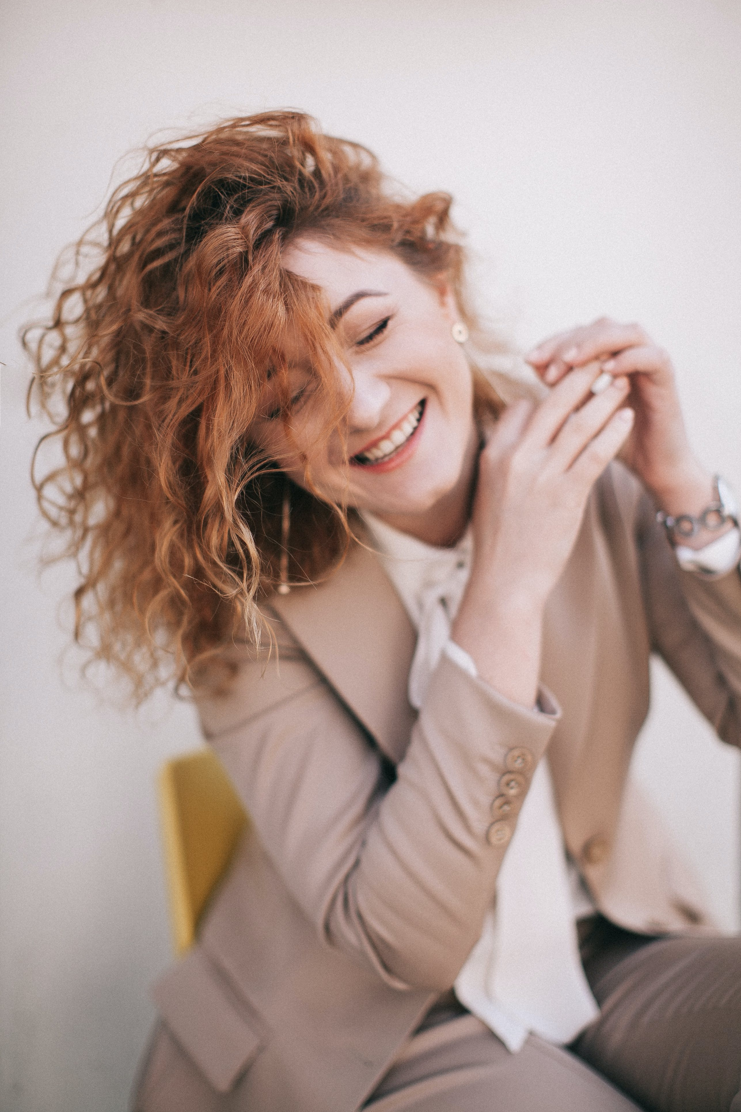 Smiling Woman Wearing Blazer