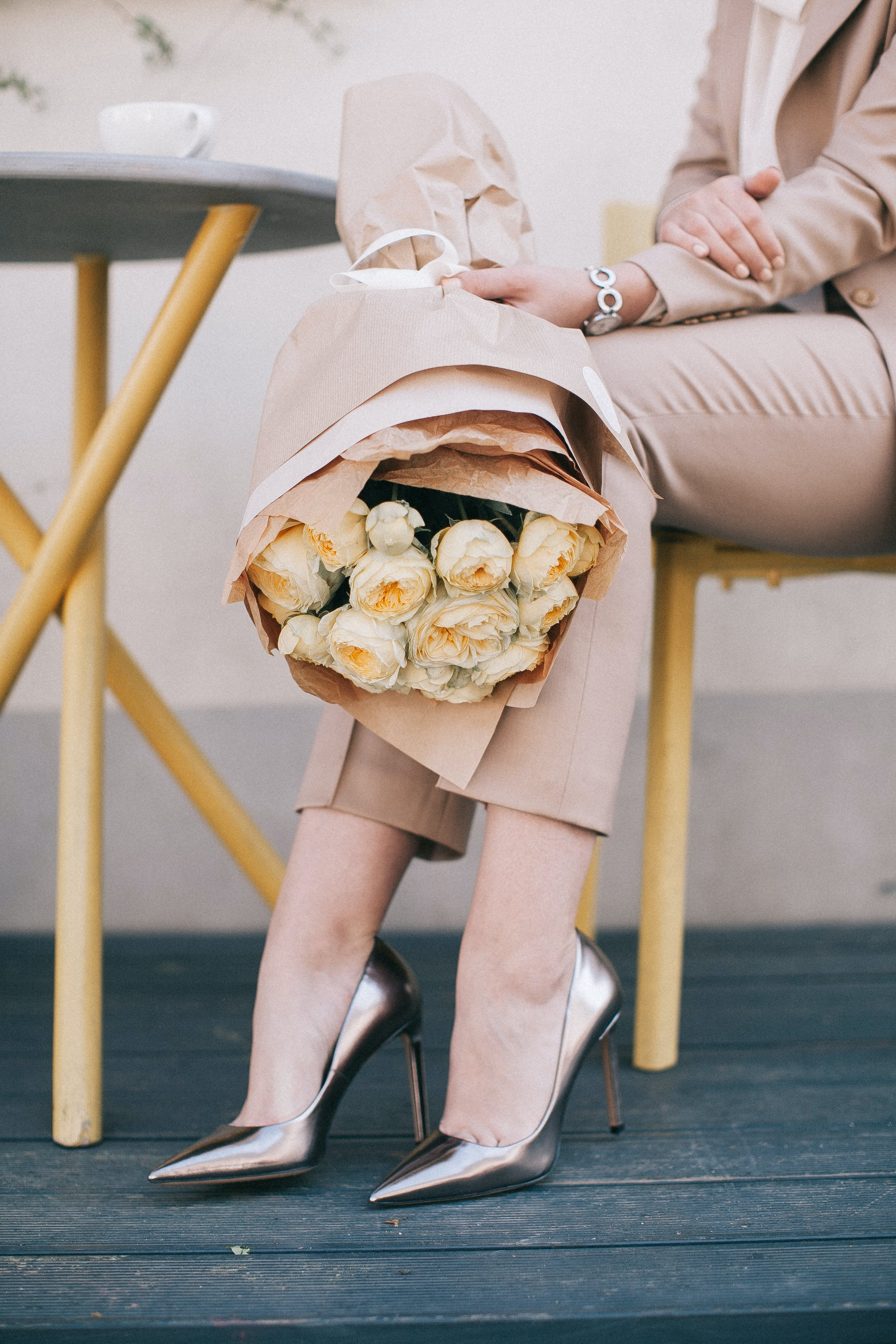 Woman Holding White Bouquet of Roses