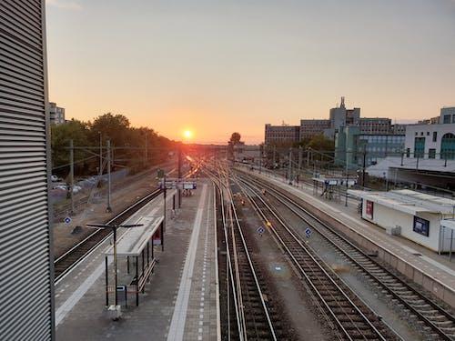 Free stock photo of clear sky, sunset, train station, train tracks