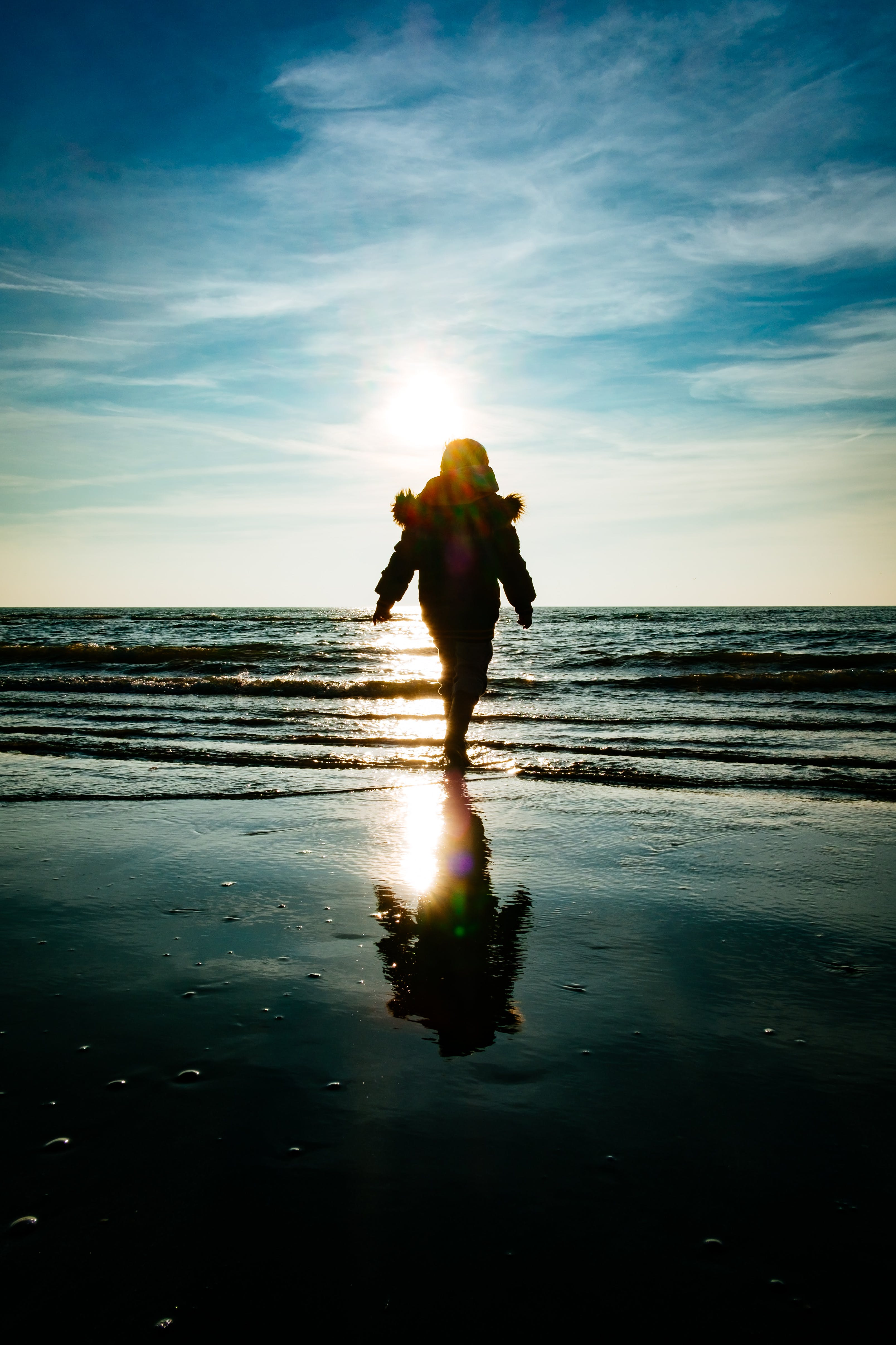 Silhouette Photography of Person Walking on Shoreline