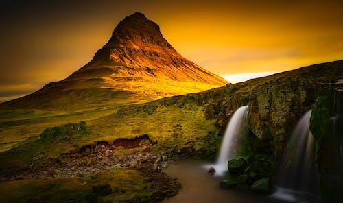 Kostnadsfri bild av berg, dagsljus, gräs, gryning