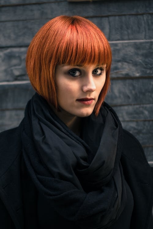Woman in Red Hair and Black Coat