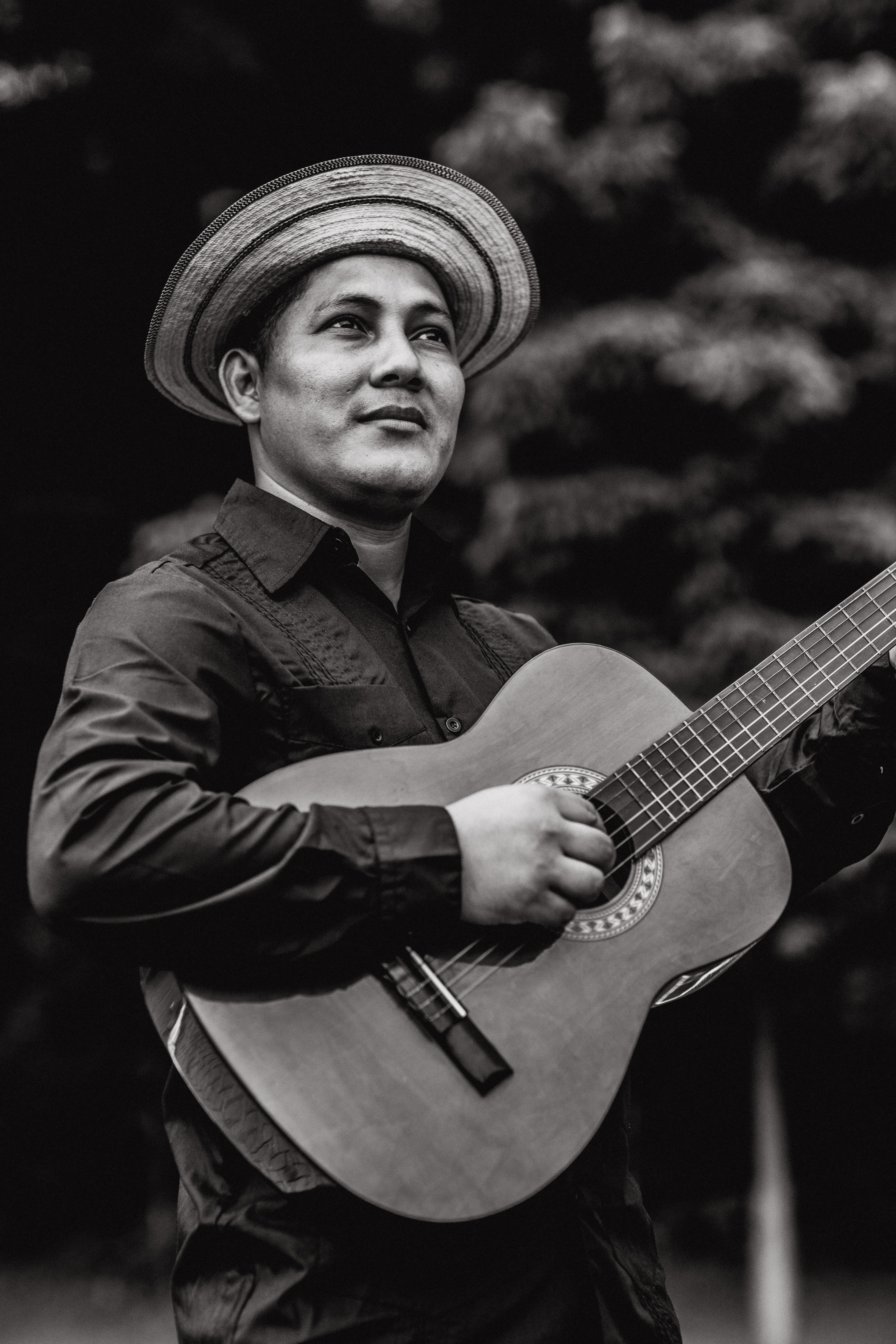 Grayscale Photography of Man Playing Guitar