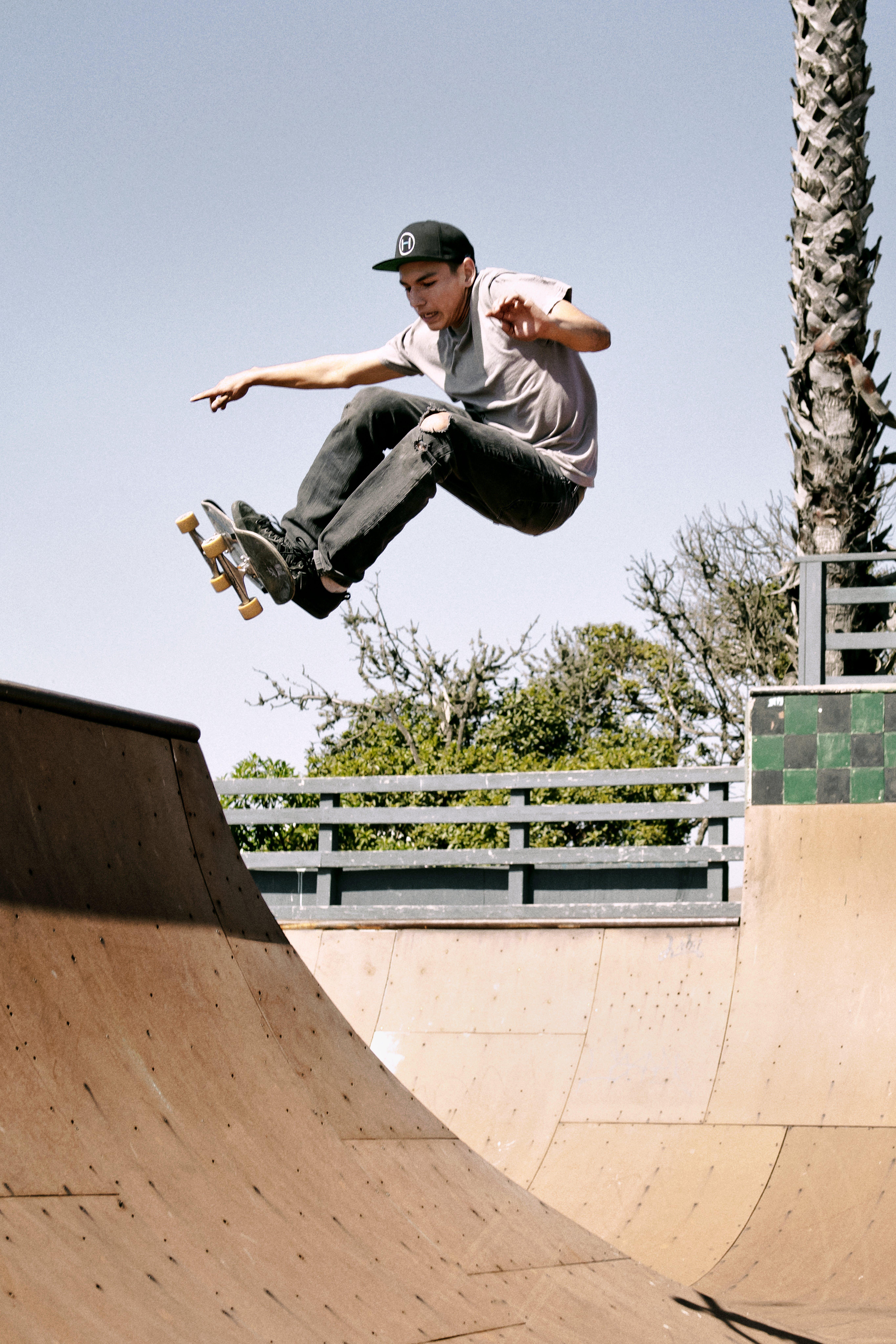 Person Skating on Skateboard Ramp