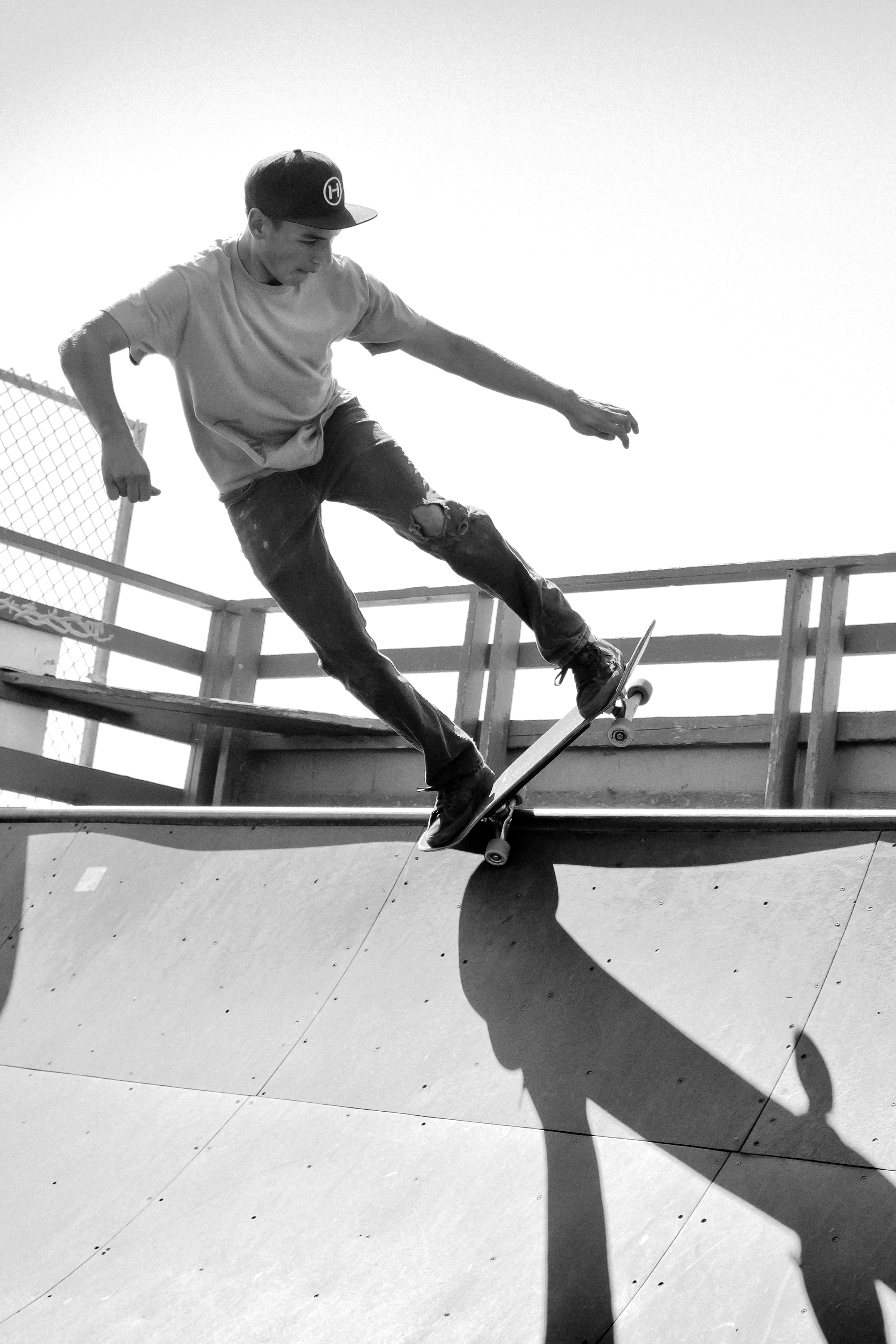 Grayscale Photography of Man Skateboarding on Ramp