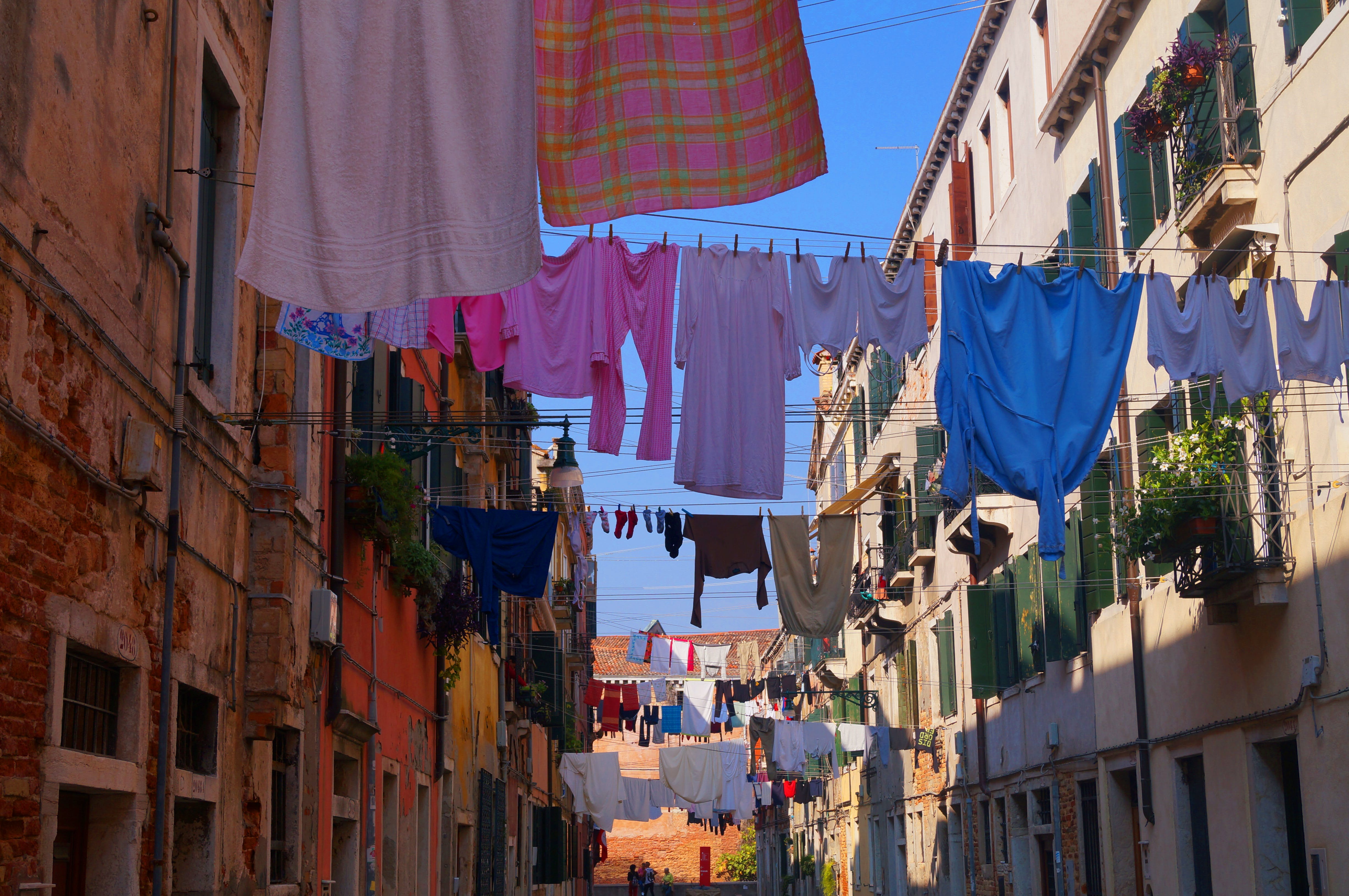 Free stock photo of blue sky, city, clothes line, colorful