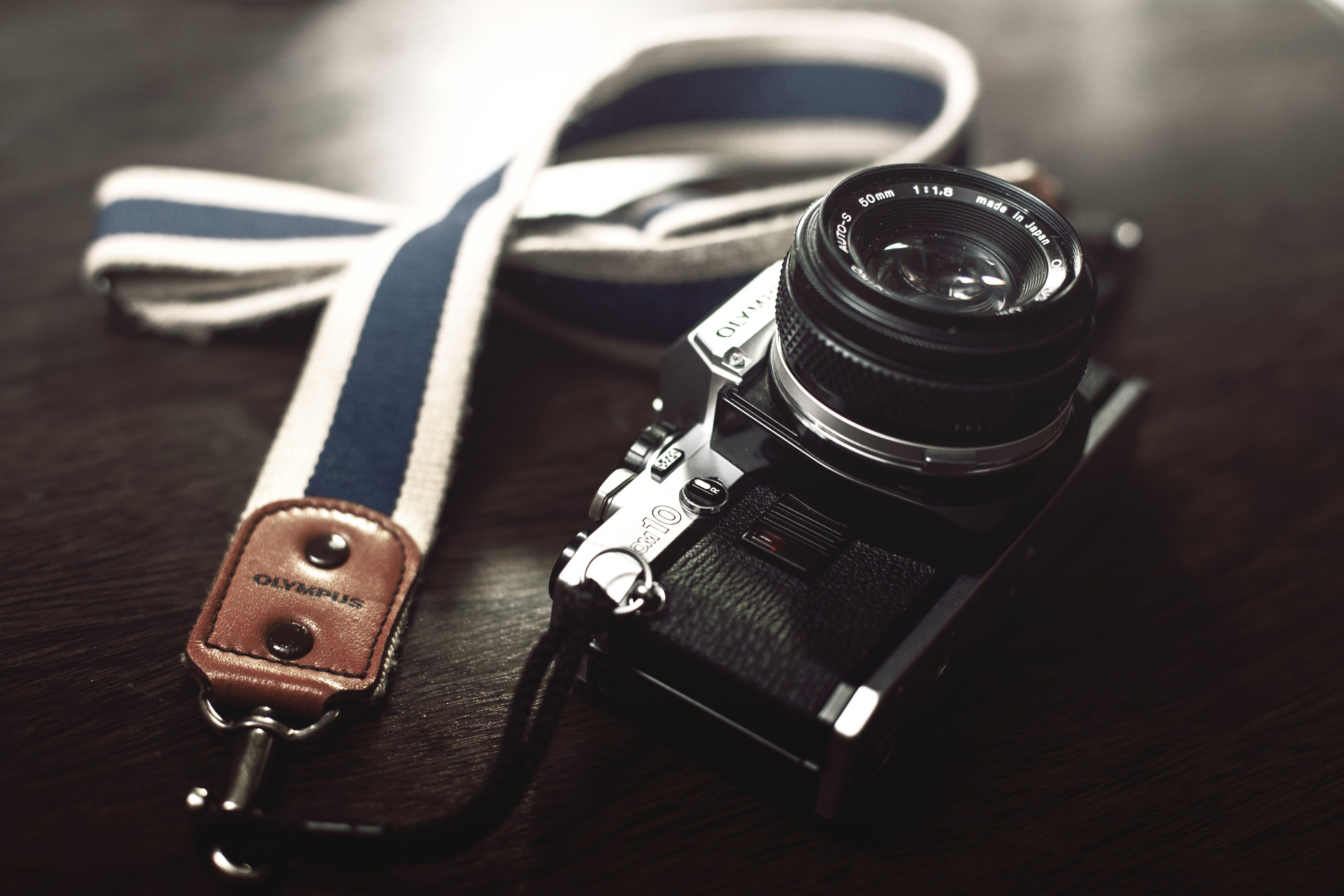 Black Dslr Camera With Leash
