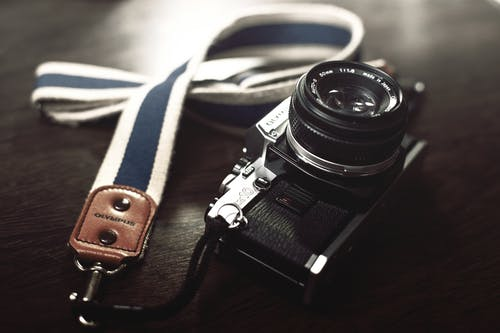 Black Dslr Camera With Leash