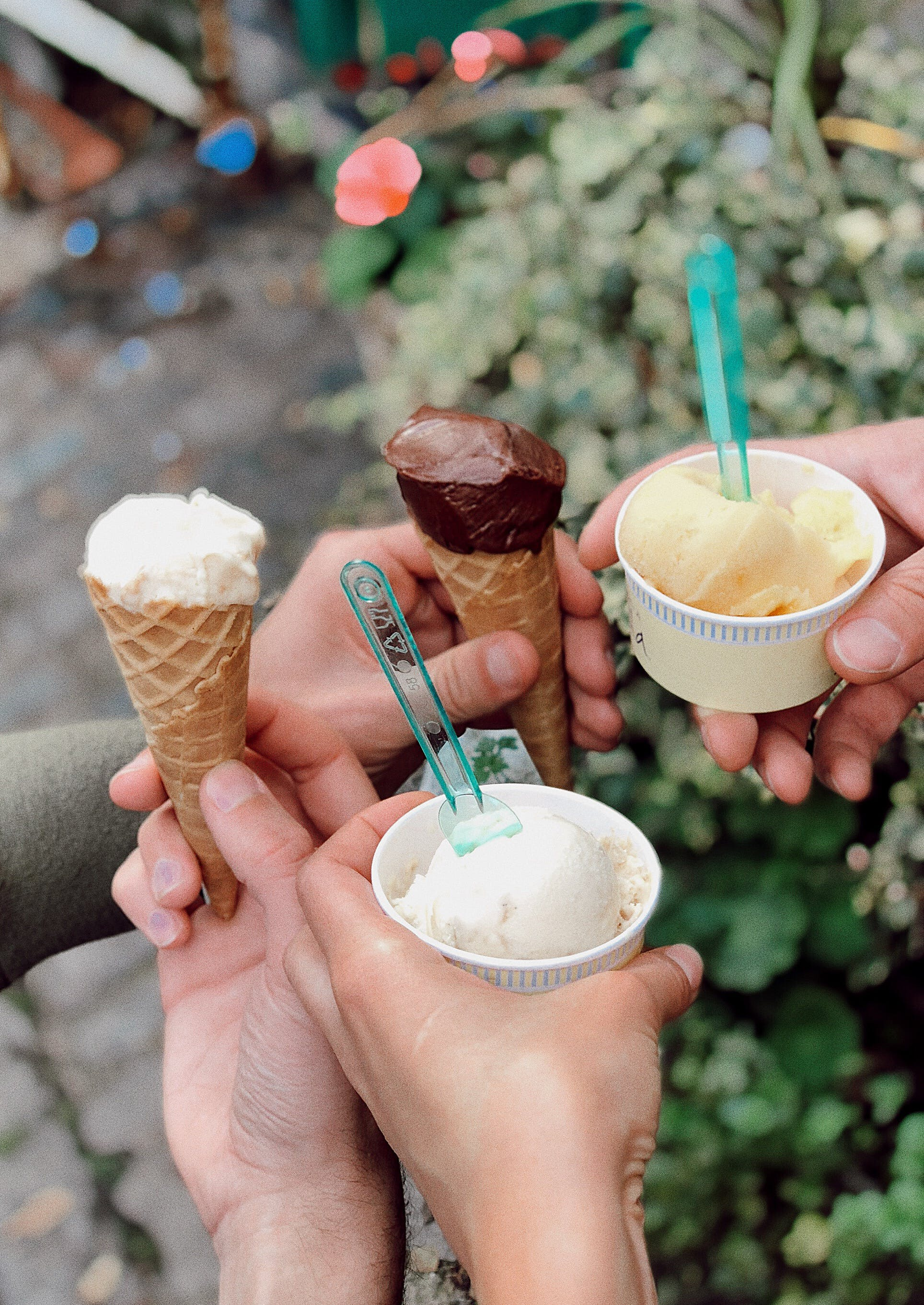 Four Persons Holding Ice Cream