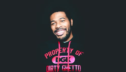 Smiling Man Wearing Black and Pink Dgk Pullover Hoodie