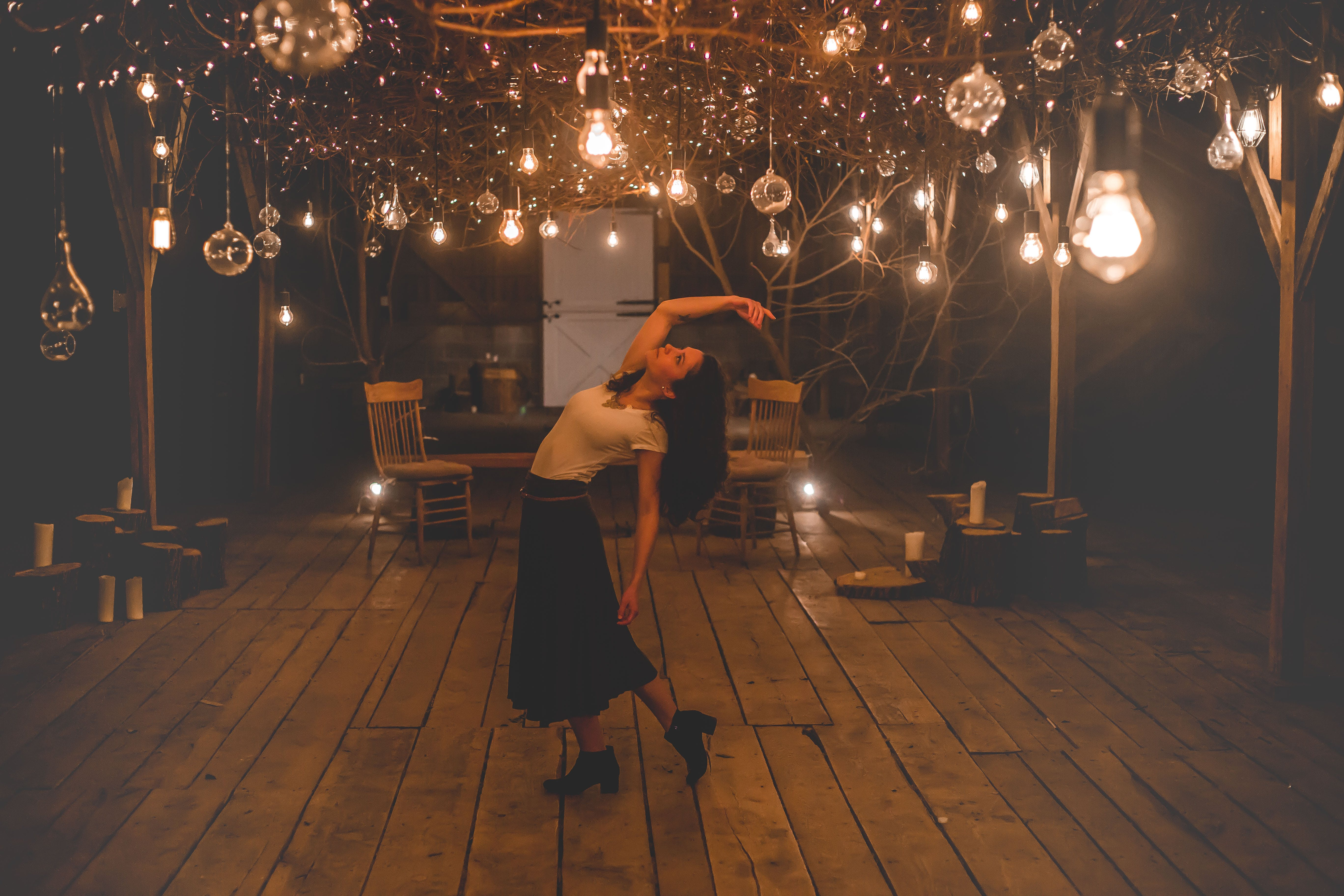 Woman Dancing on Terrace With Lights Turned-on