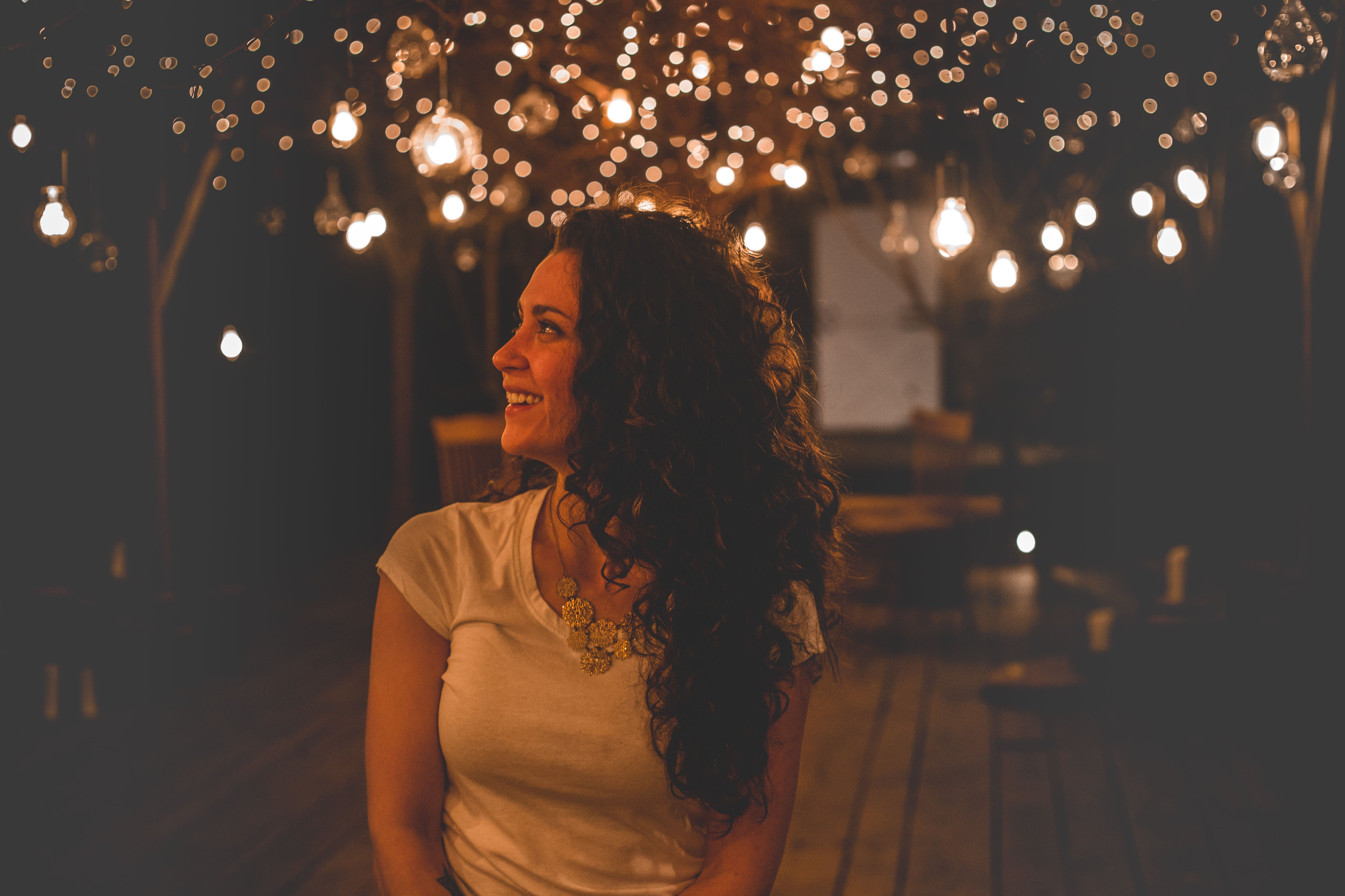 Smiling Woman Under String Lights