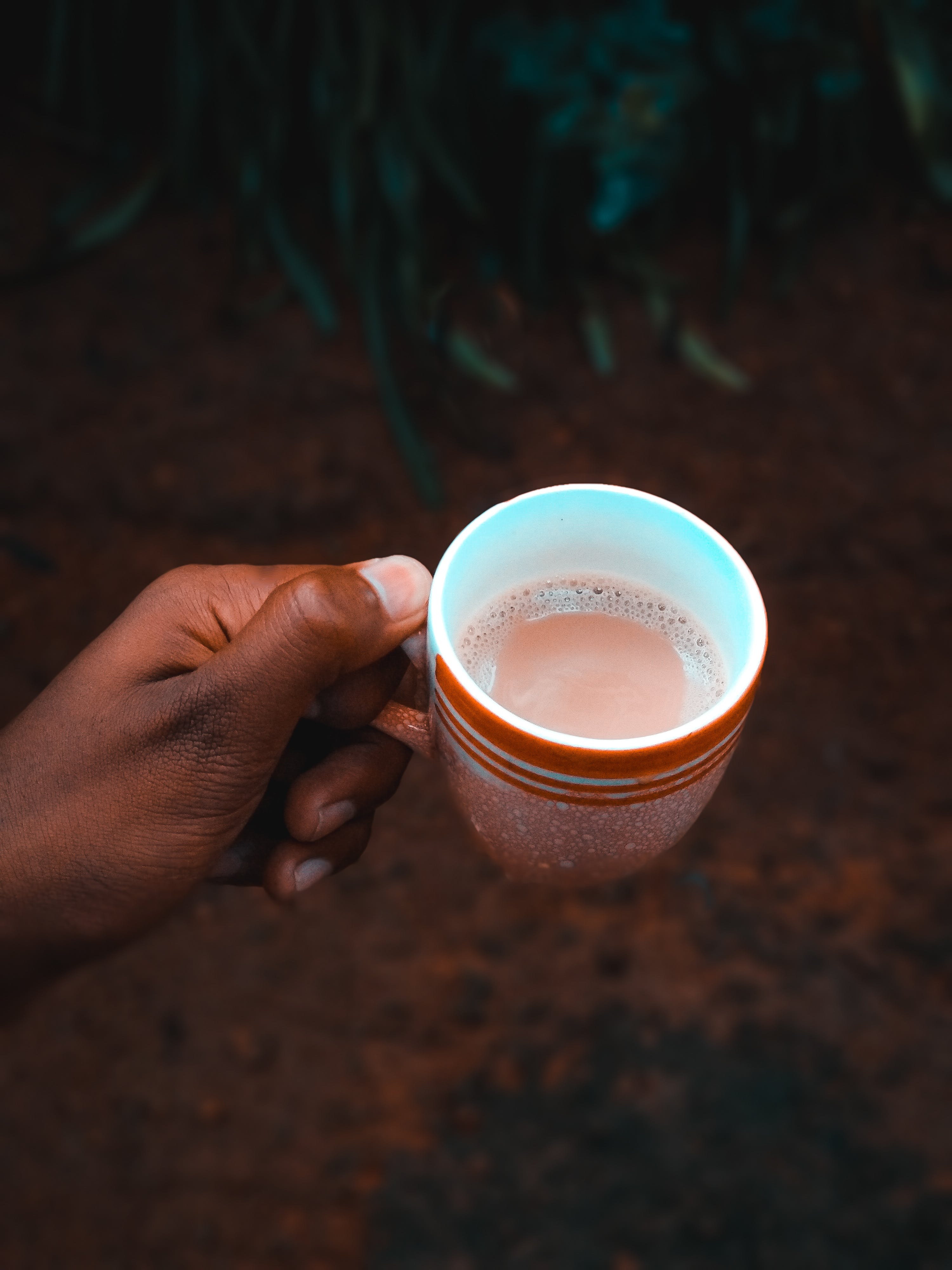 Close-Up Photo of Person Holding Cup