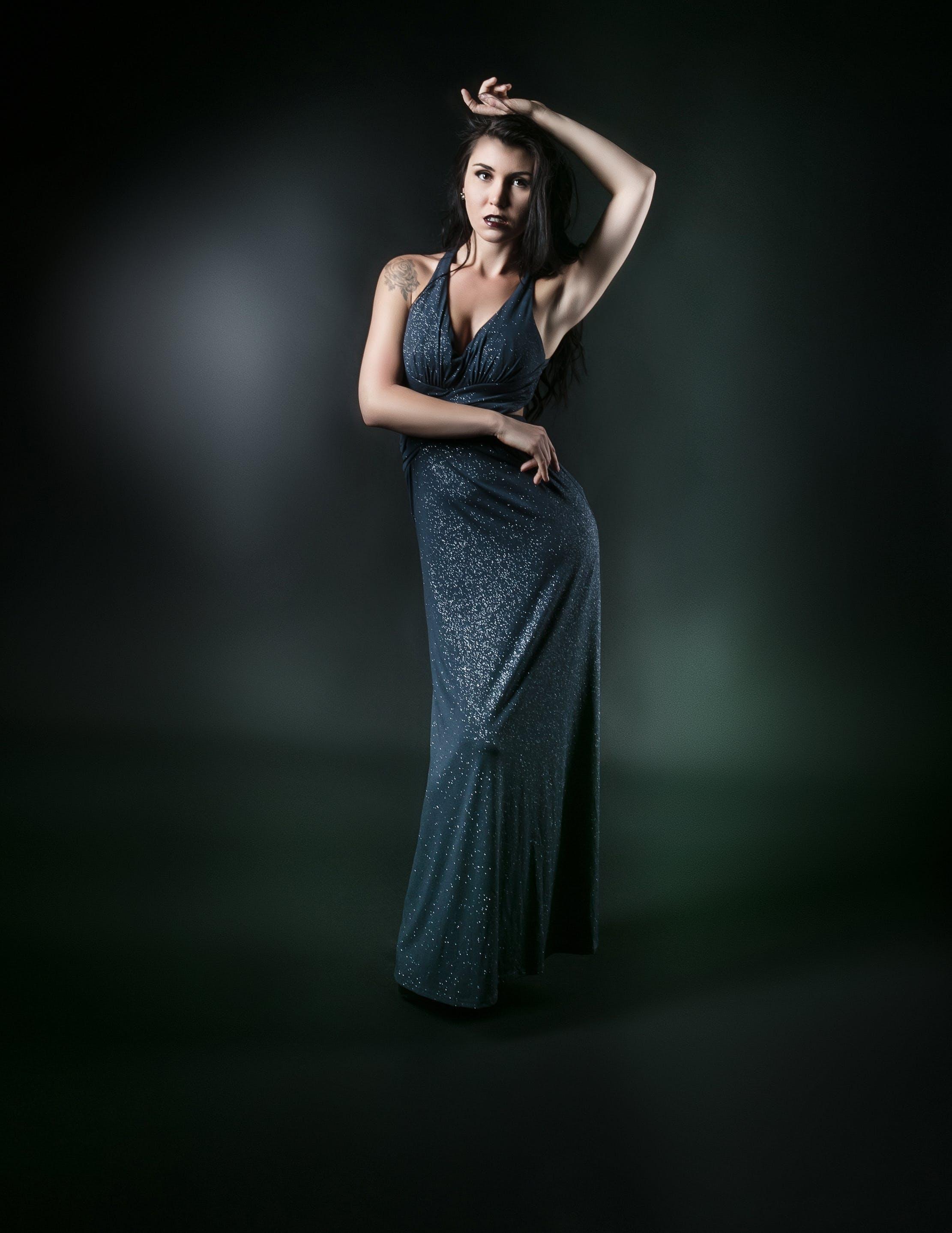 Standing Woman in Gray Surplice Sleeveless Dress