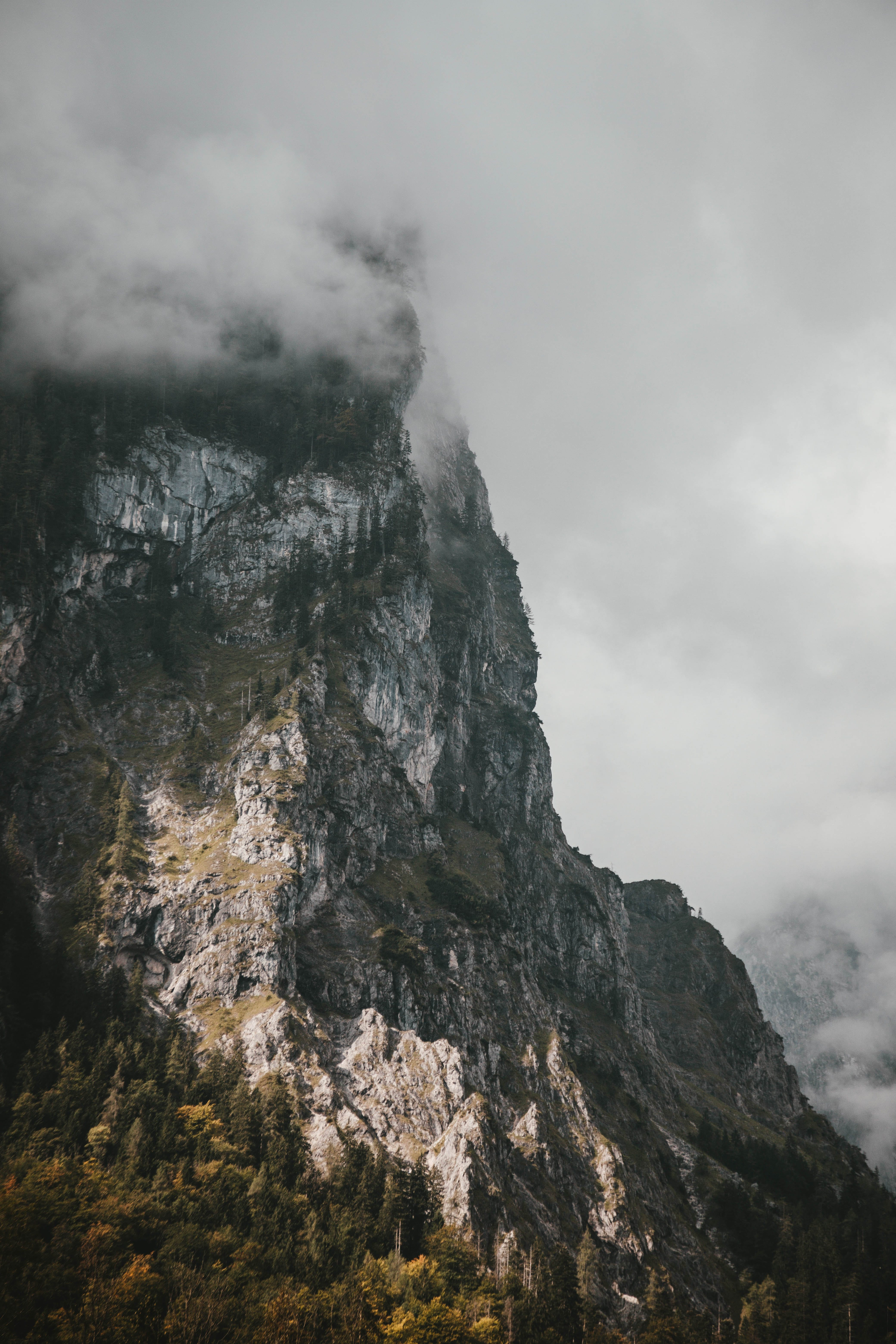 Gray Mountain Surrounded by Clouds