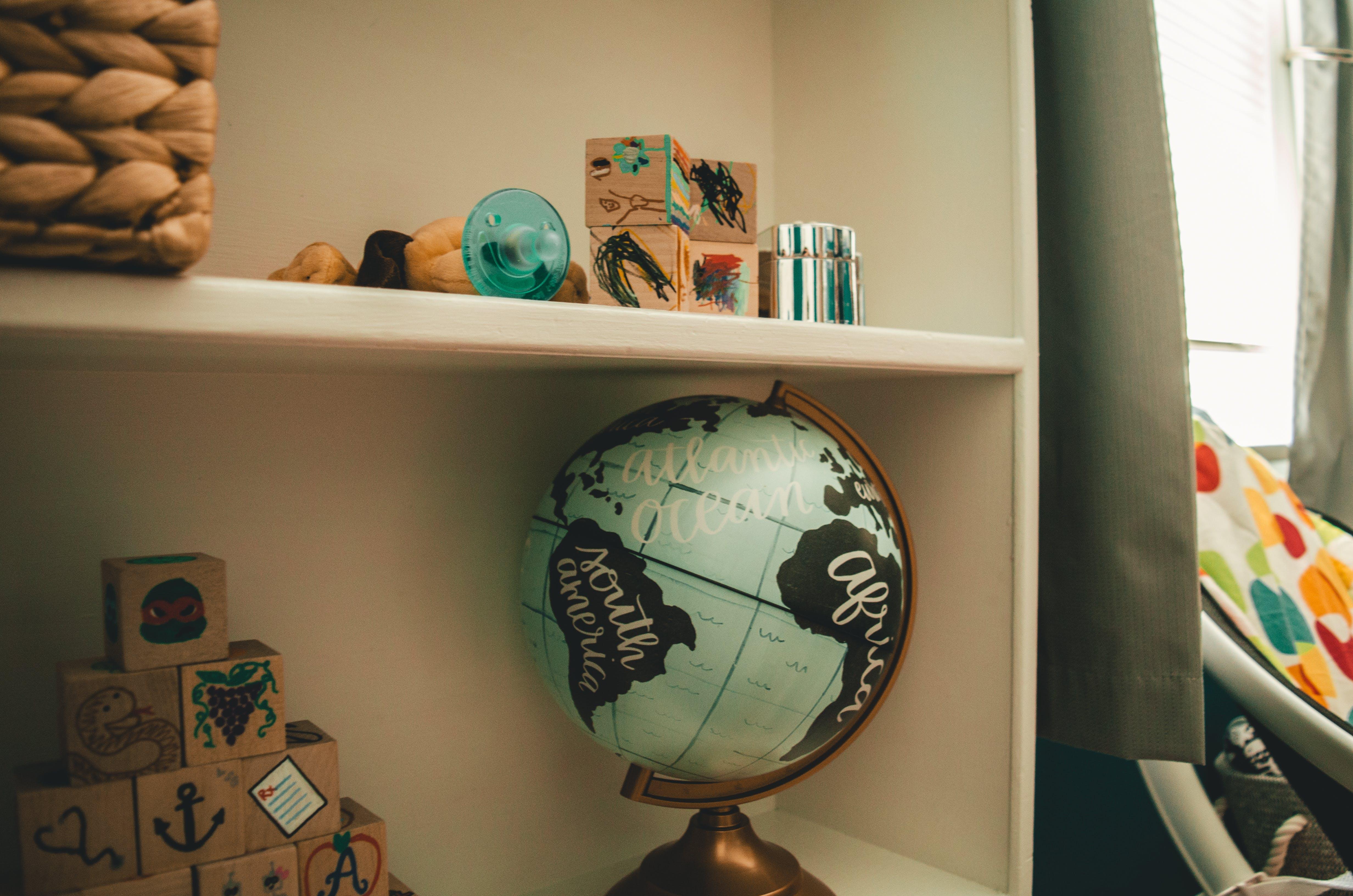 Free stock photo of home, toys, baby, globe