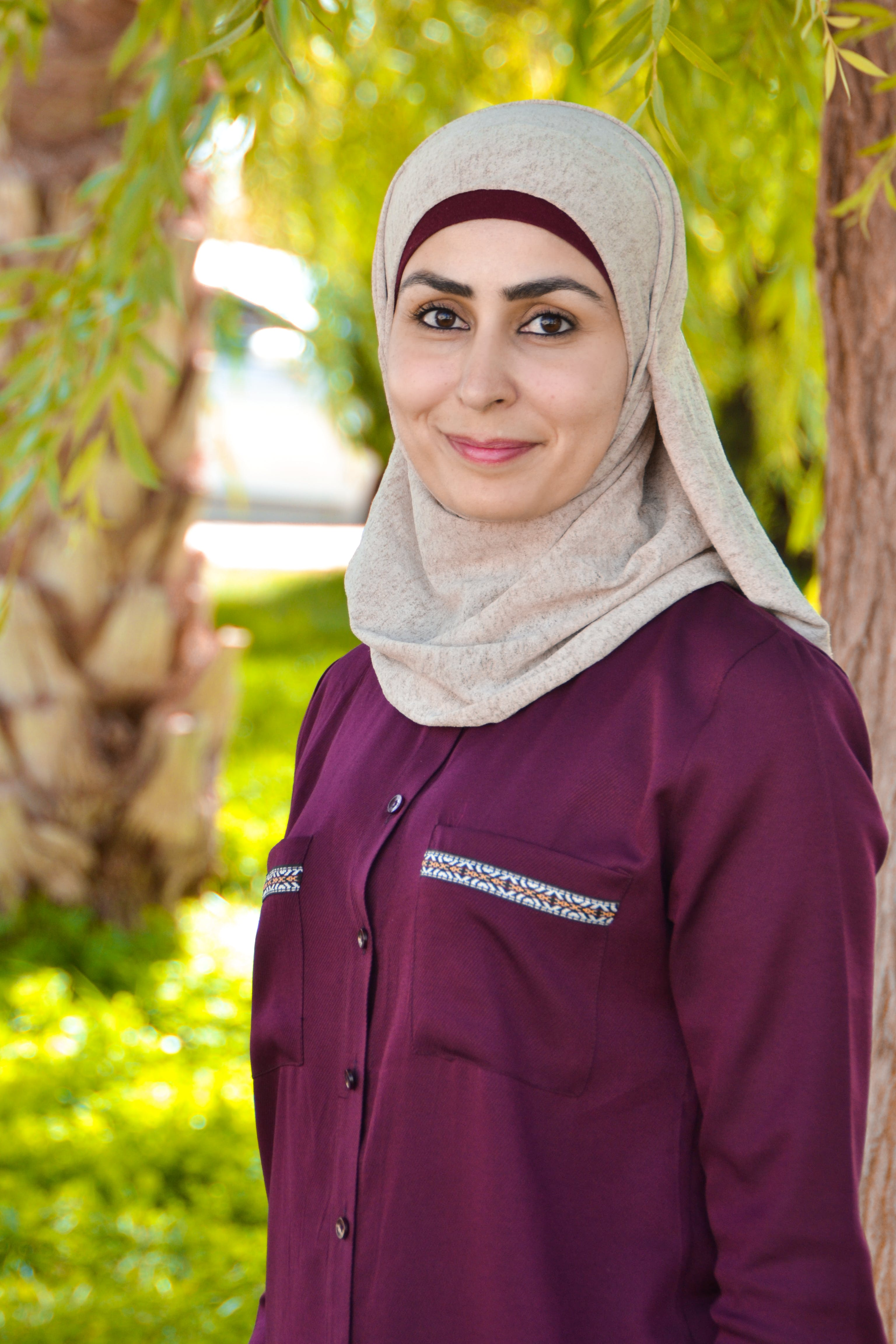 Photo of Woman in Red Abaya