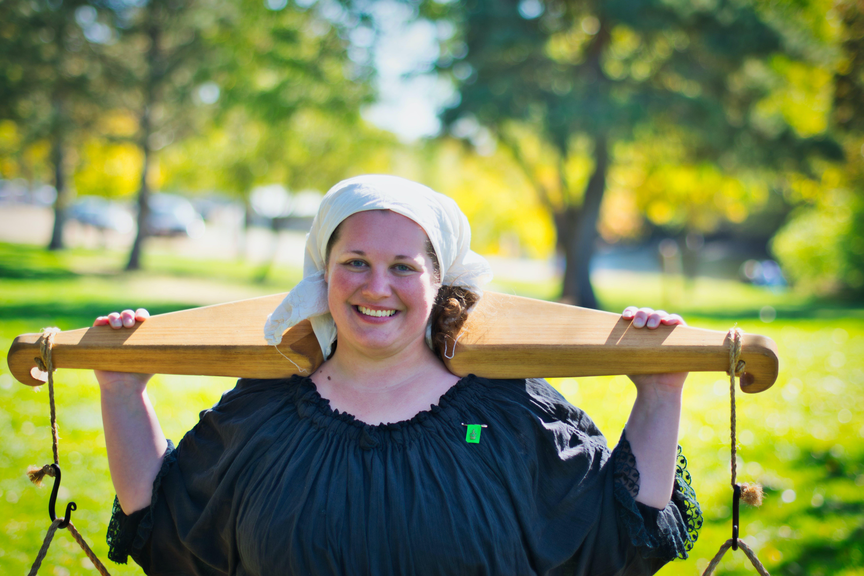 Smiling Woman Carrying Wooden Yoke