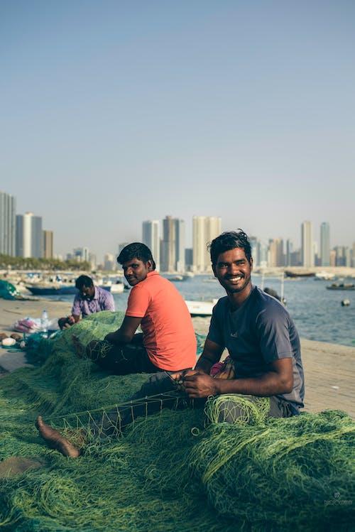 Fotos de stock gratuitas de adultos, agua, ciudad, costa