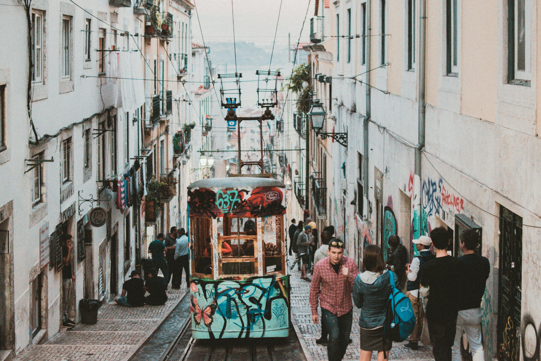 Photo of People Walking Beside Tram Train