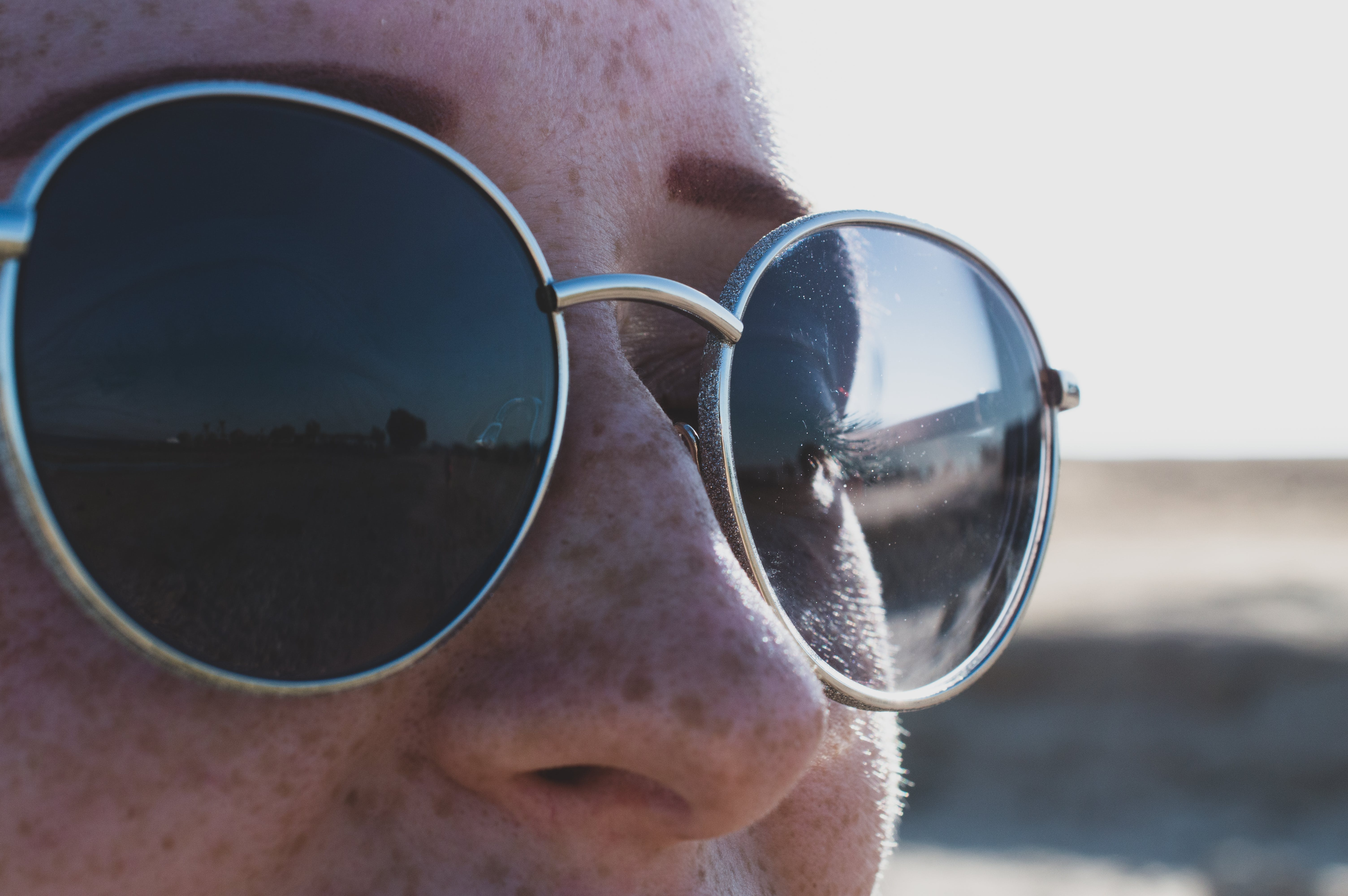 Person Wearing Gray Framed Sunglasses