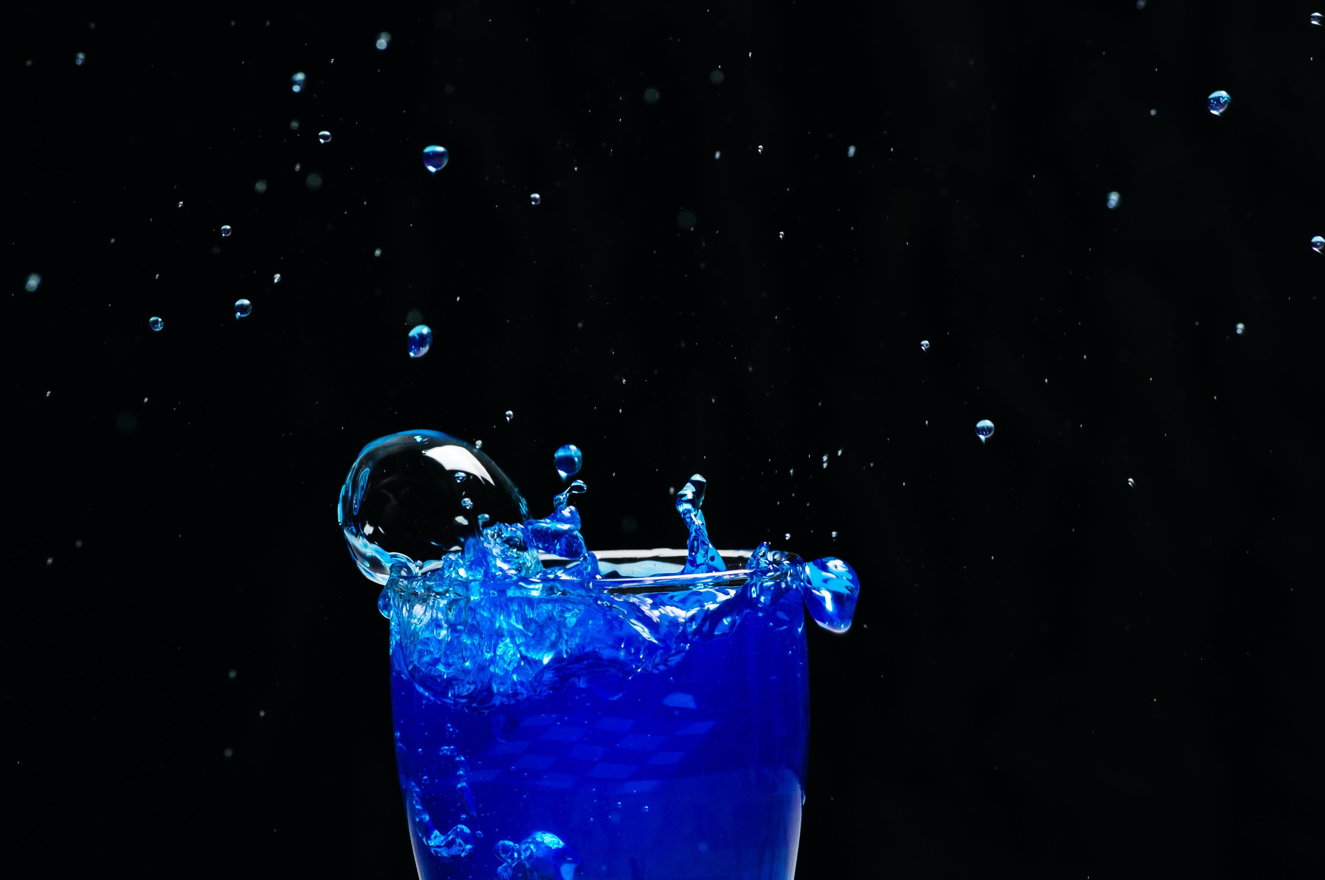 Blue Liquid Splash on Glass