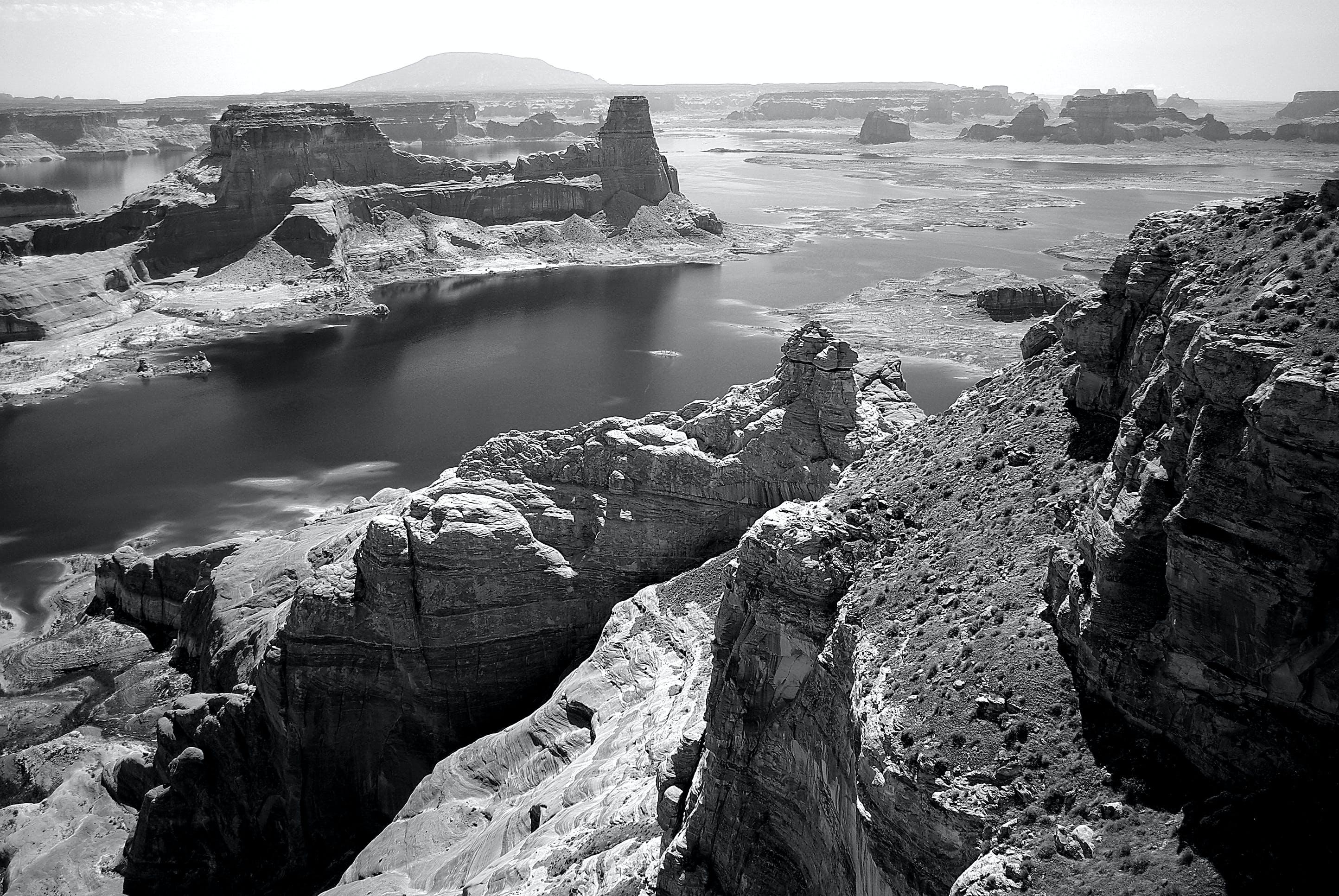 Grey Concrete Rock Beside Body of Water