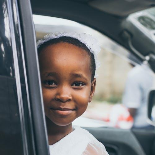 Smiling Girl Wearing White Top Inside Car