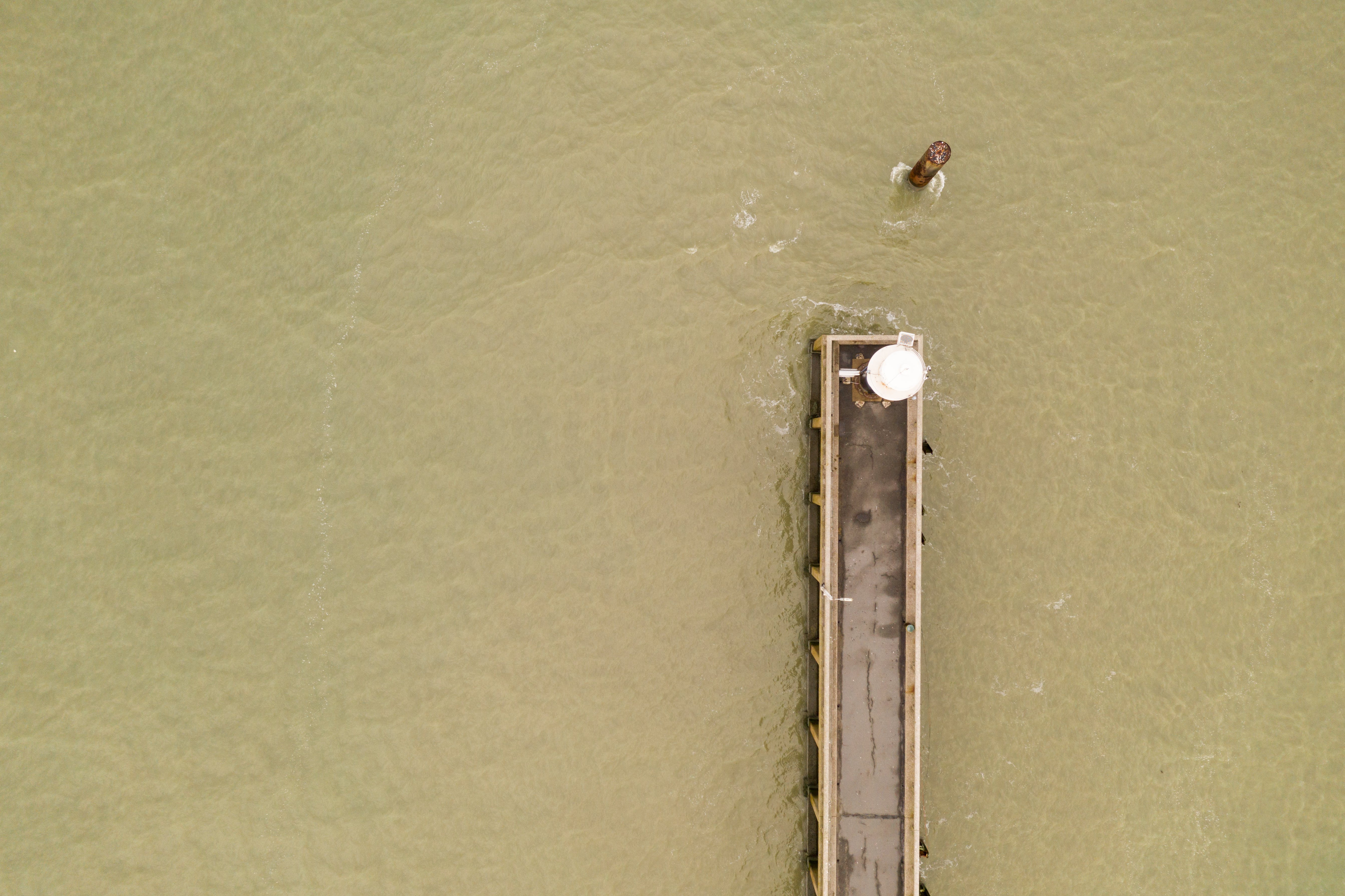 Aerial View of Dock on Beige Body of Water