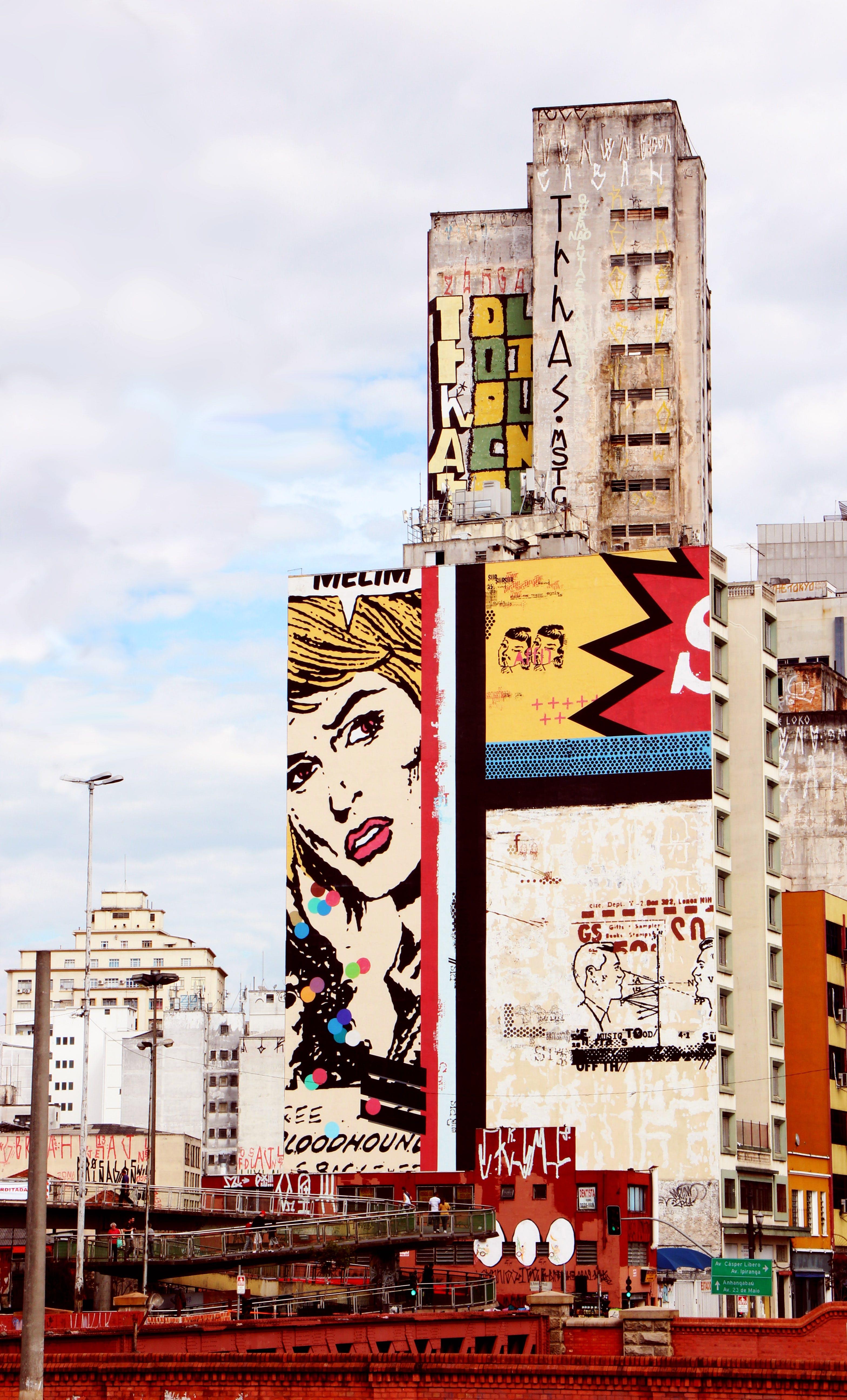 Graffiti on White Concrete Building