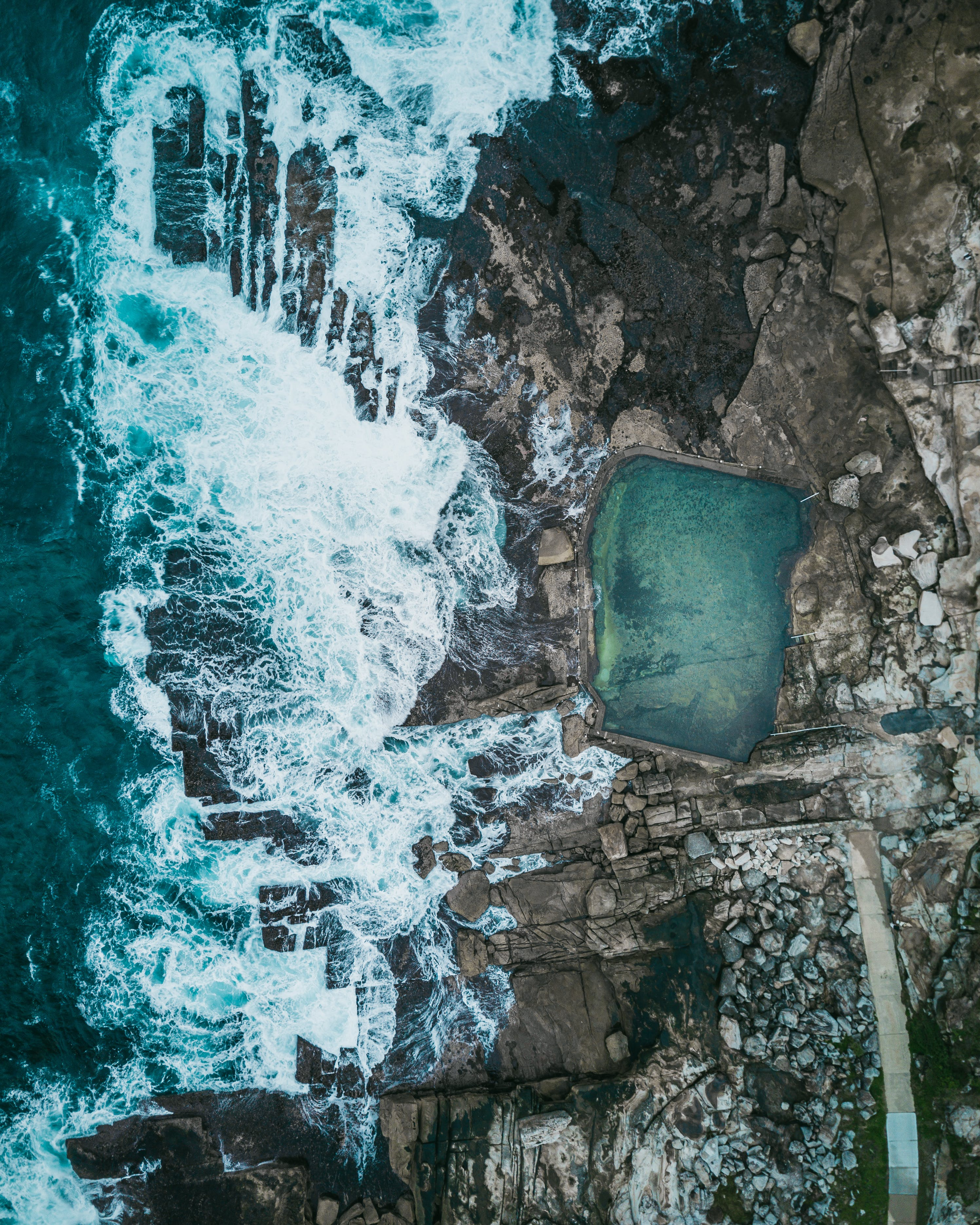 Natural Pool Beside Sea and Rock Formation Aerial Photography